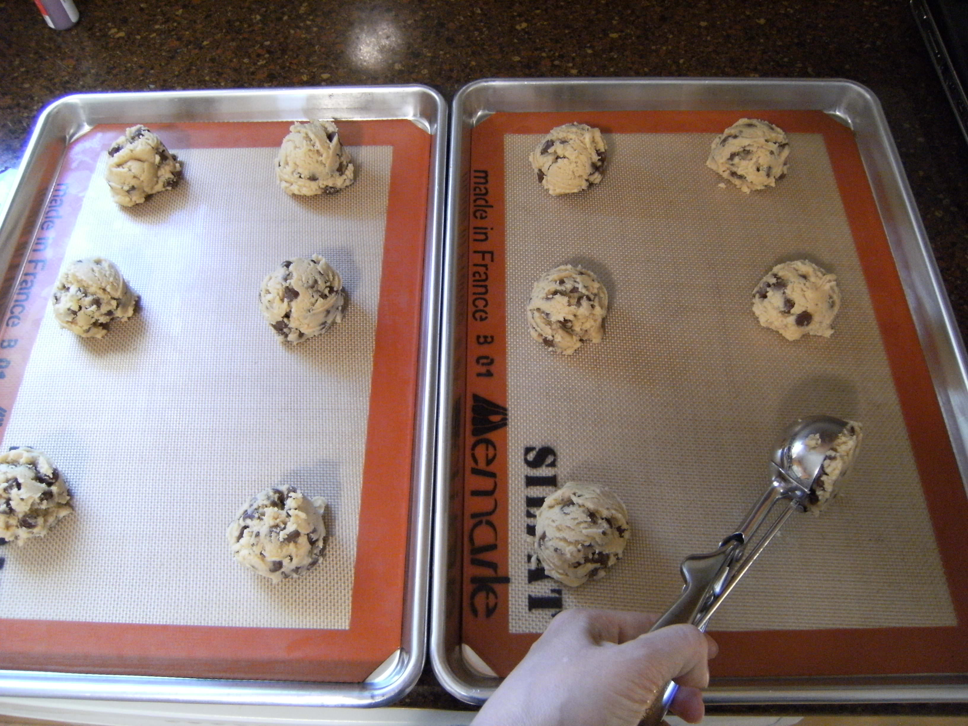 chocolate chip cookie dough on sheet pans