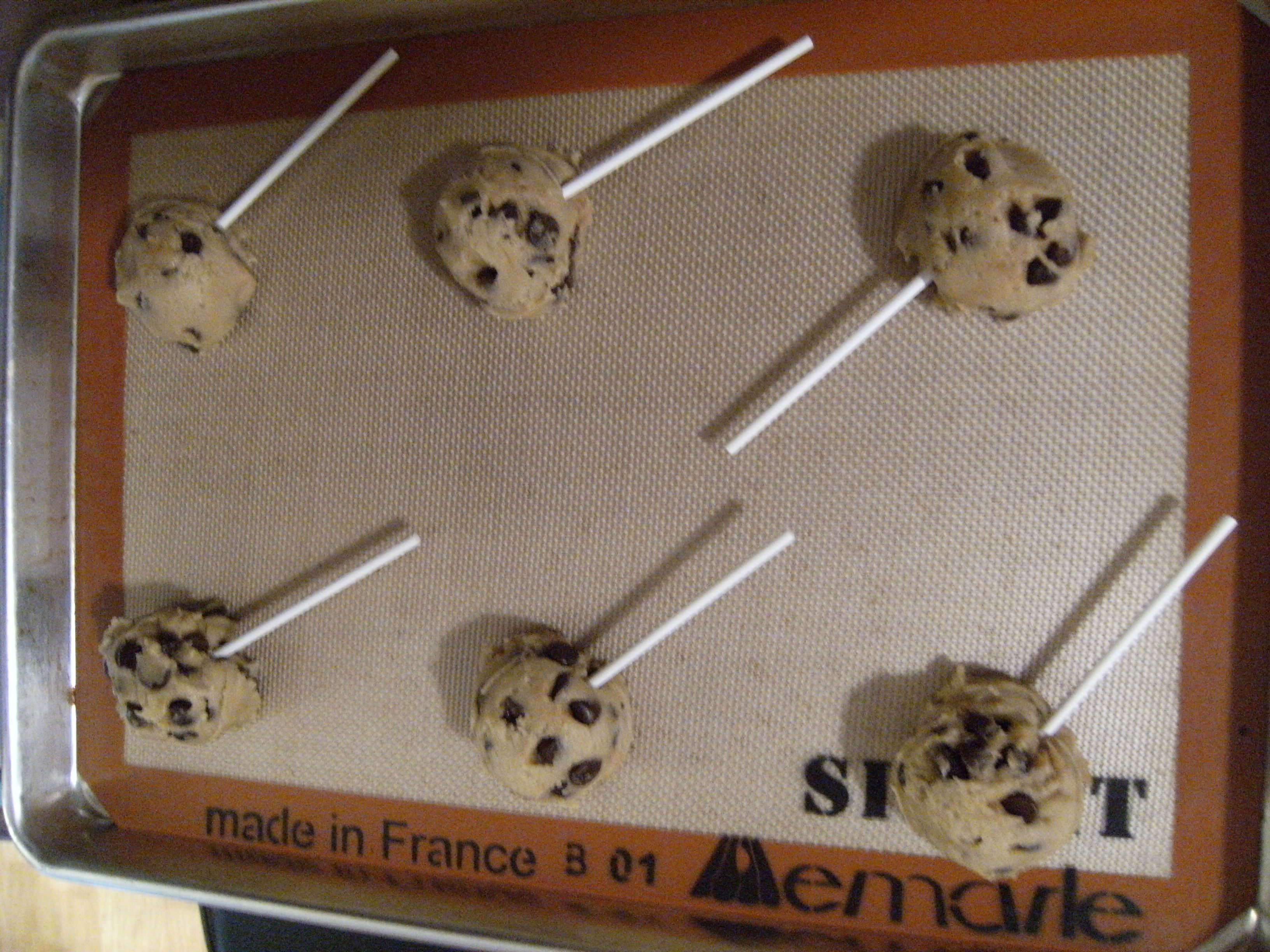 Place lollipop sticks into raw chocolate chip cookie dough and bake them into cookie pops!