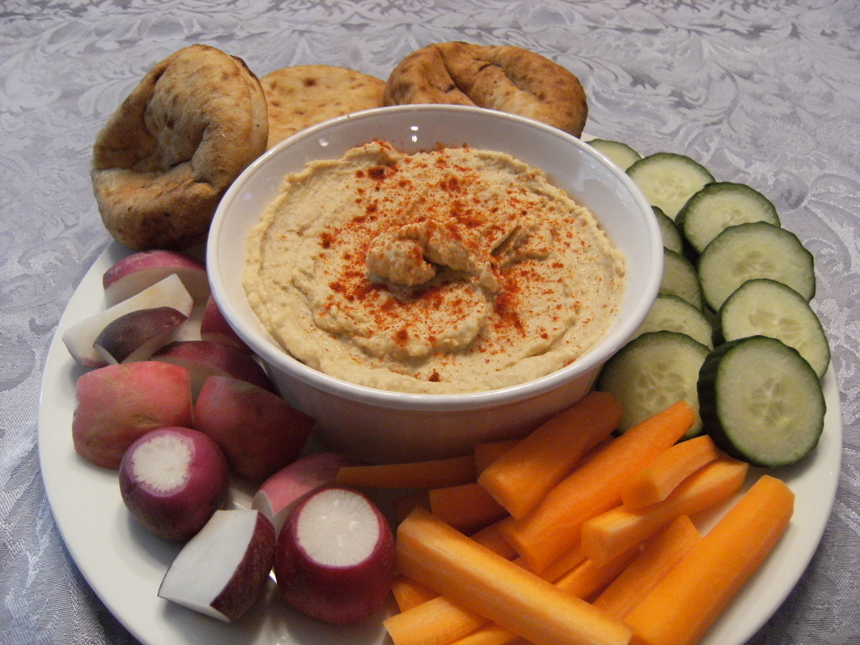Mediterranean hummus is a spread made from garbanzo beans (chickpeas) and tahini. It's a healthy snack dip that's delicious warm or cold! - Get the recipe on ComfortablyDomestic.com