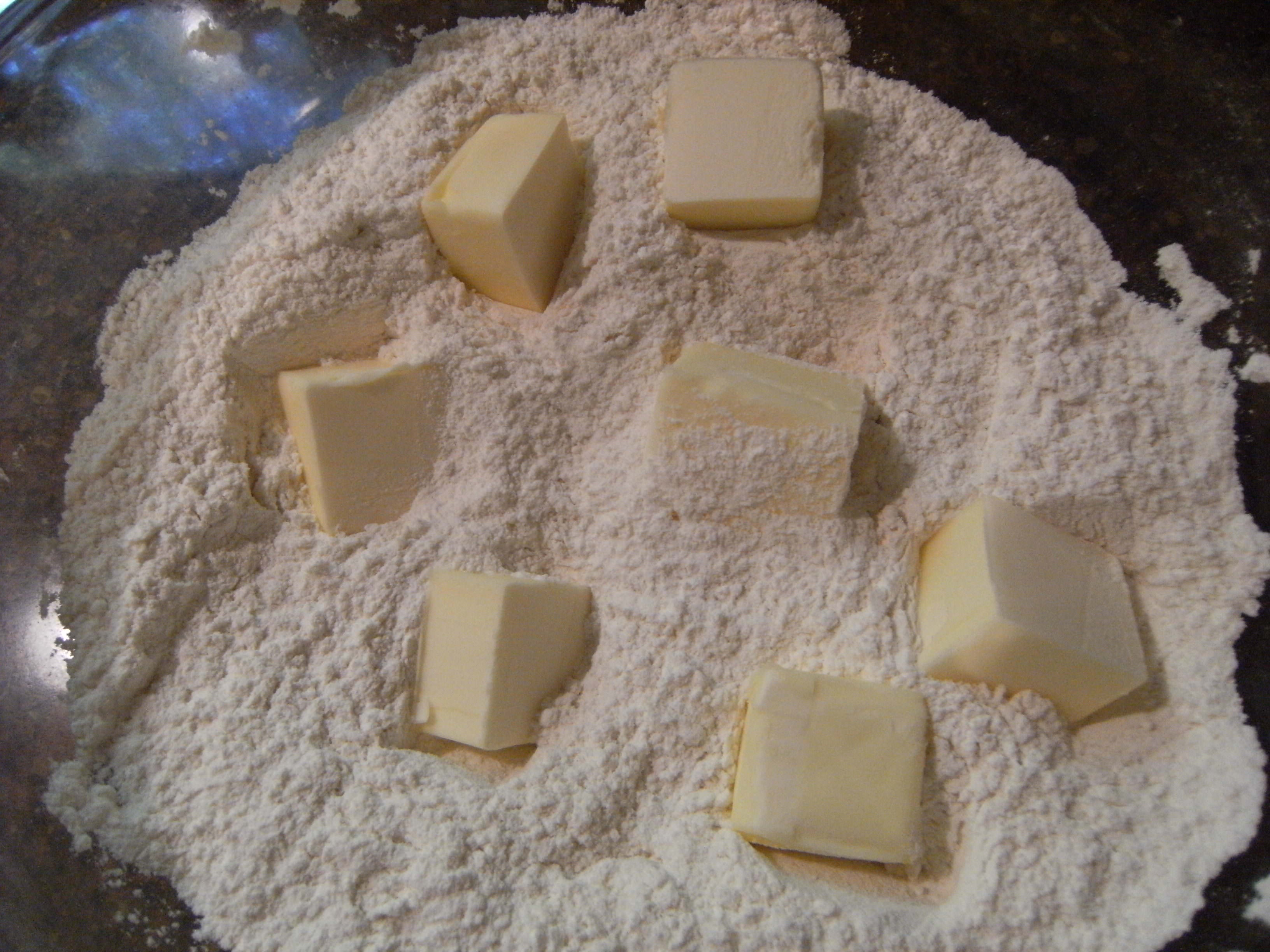 incorporating butter into dry ingredients for homemade biscuits