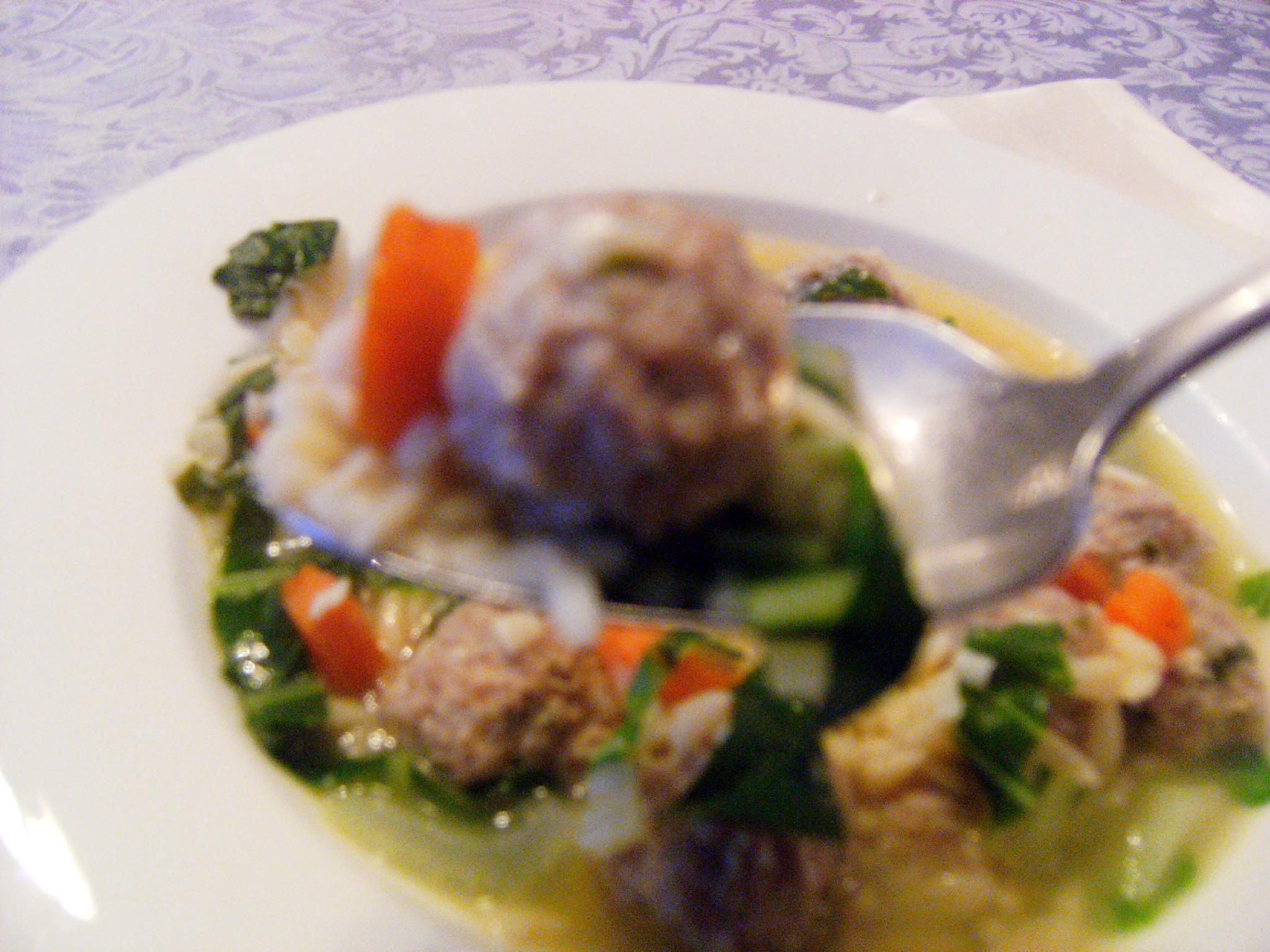 A bowl of turkey meatball soup