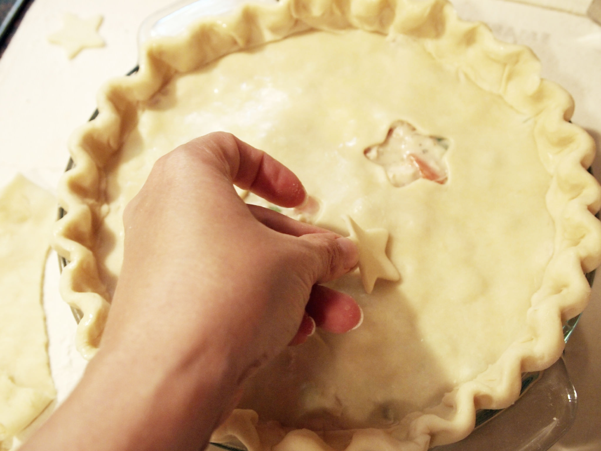 applying crust cut-outs to a chicken pot pie
