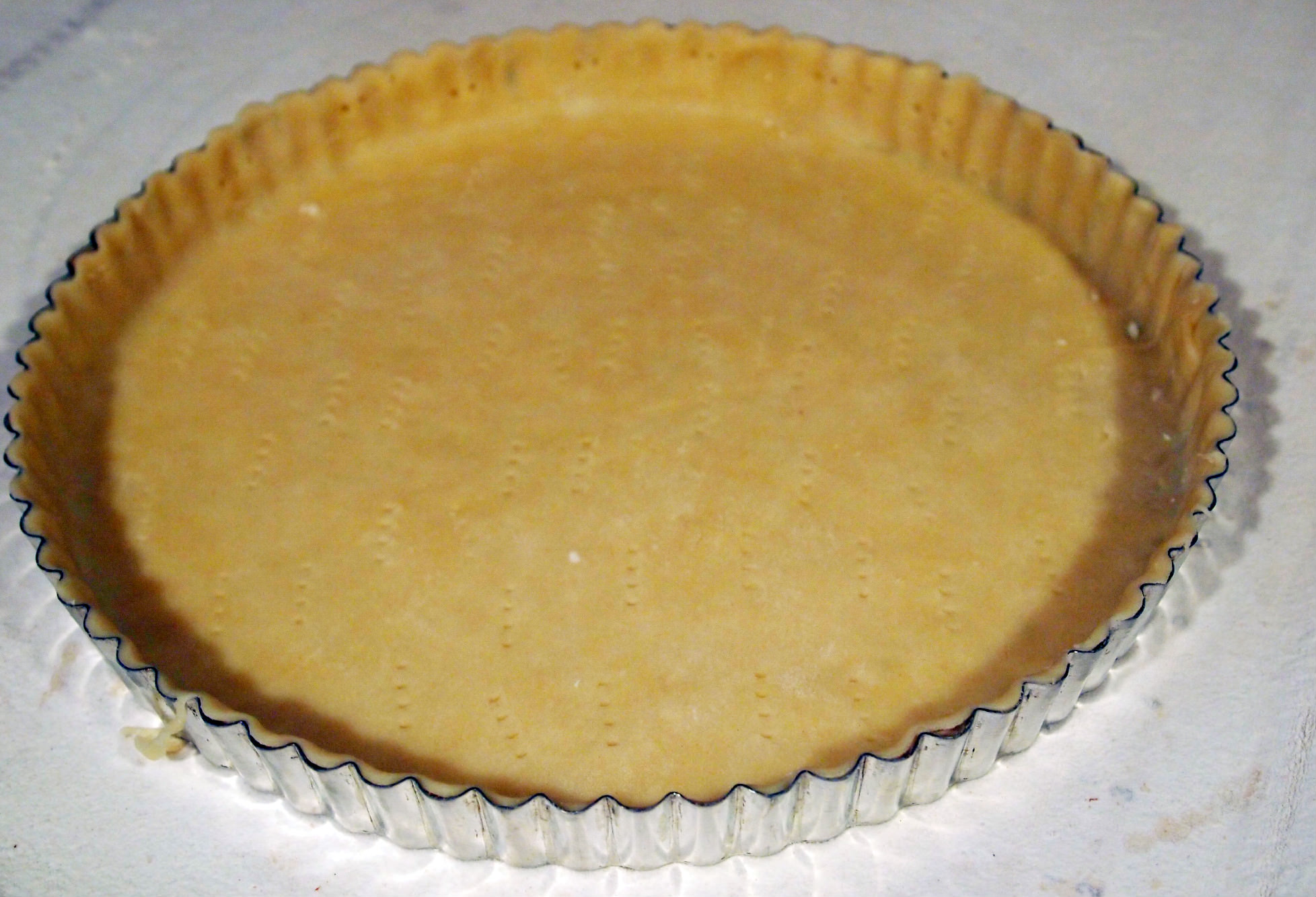 tart pan filled with pastry dough