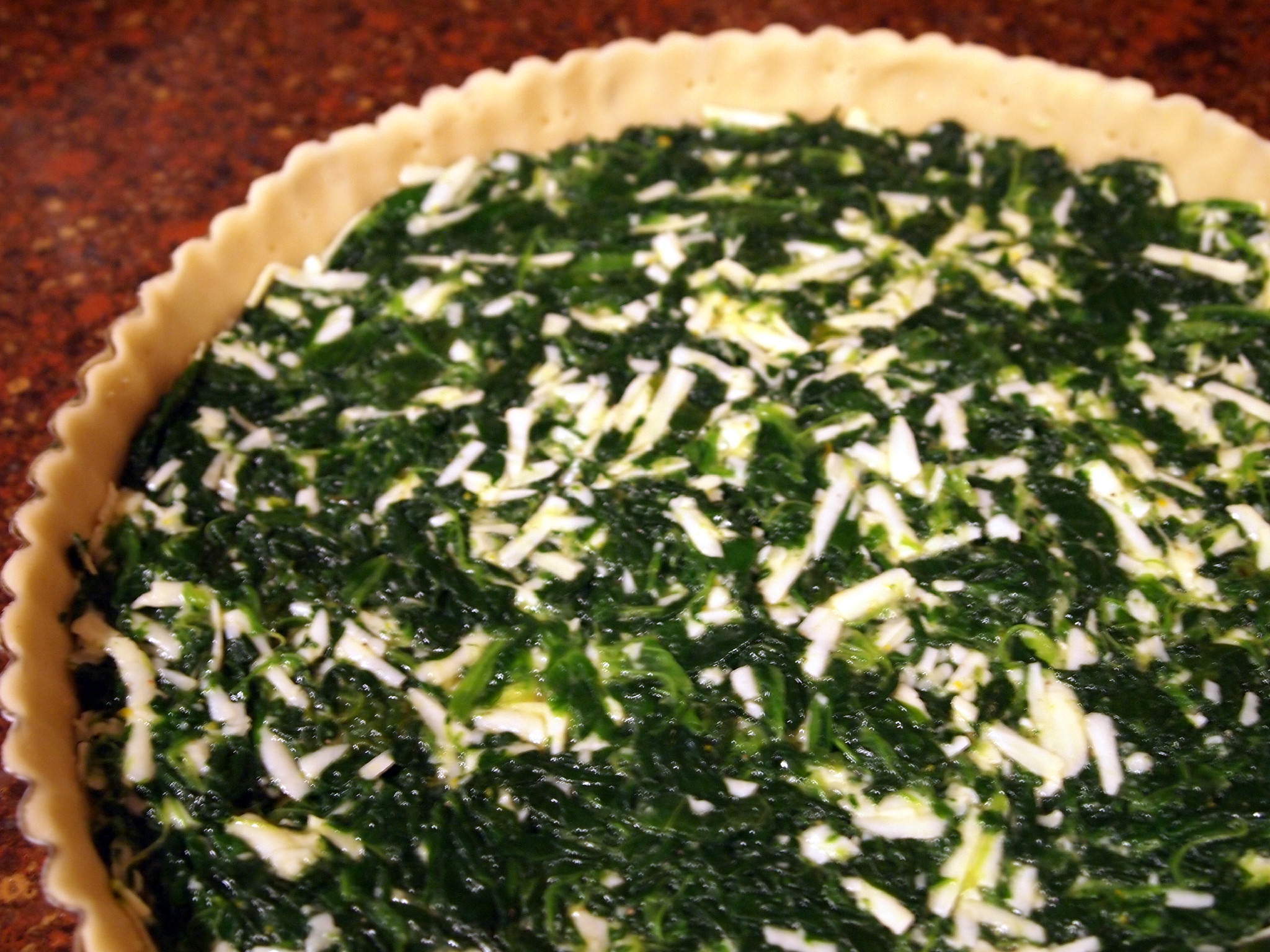 tart shell, filled with spinach and cheese filling