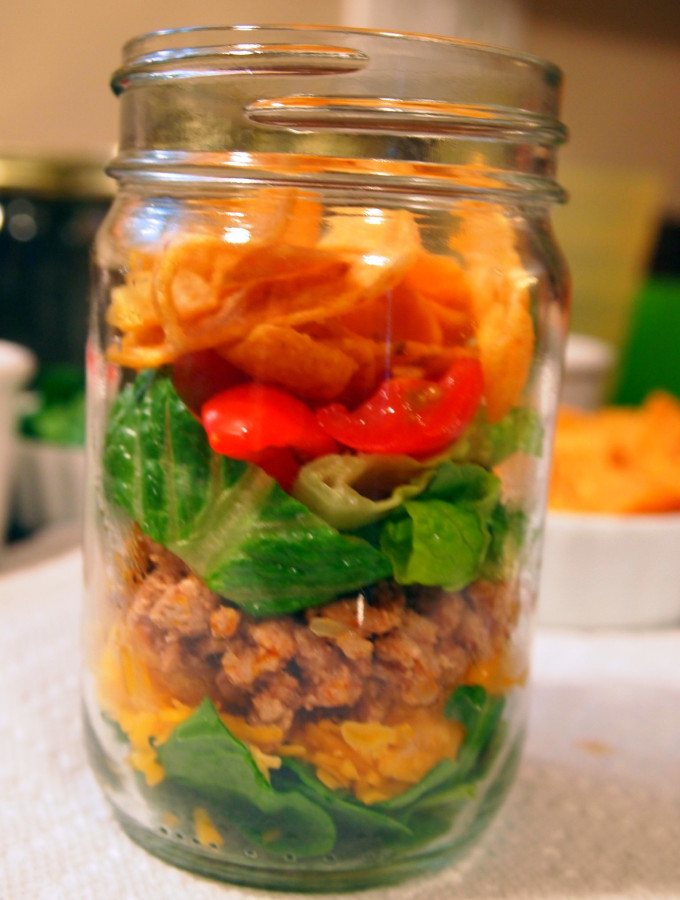 A lightened up version of walking tacos, these are made with ground turkey instead of ground beef. Served in mason jars for extra portability and fun!   ComfortablyDomestic.com