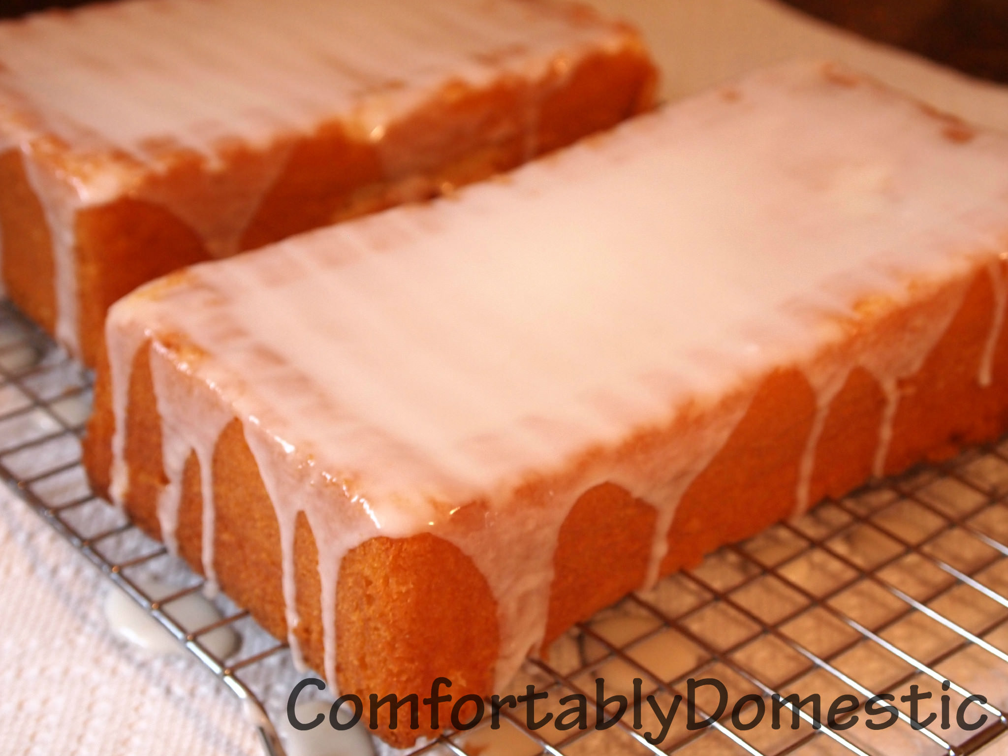 Iced lemon loaf is the perfect treat with a cup of coffee. Now there's no need to get it at the local coffee shop, because you can make it at home for a fraction of the cost!