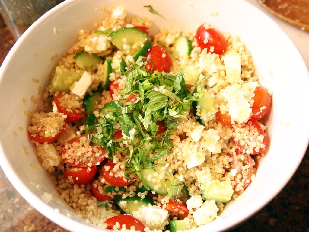 Greek quinoa salad is a fresh, light side dish, packed with wholesome quinoa, fresh cucumbers, grape tomatoes, mint, and feta cheese. | ComfortablyDomestic.com