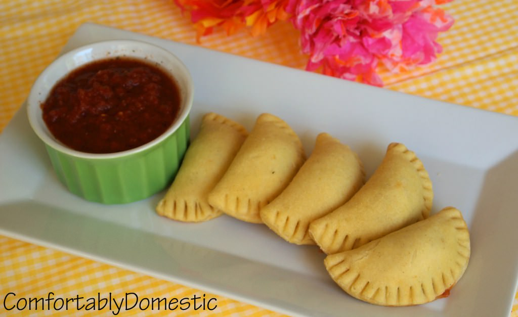 Spicy chicken empanadas are a bite sized appetizer, perfect for parties or a Cinco de Mayo celebration! | ComfortablyDomestic.com