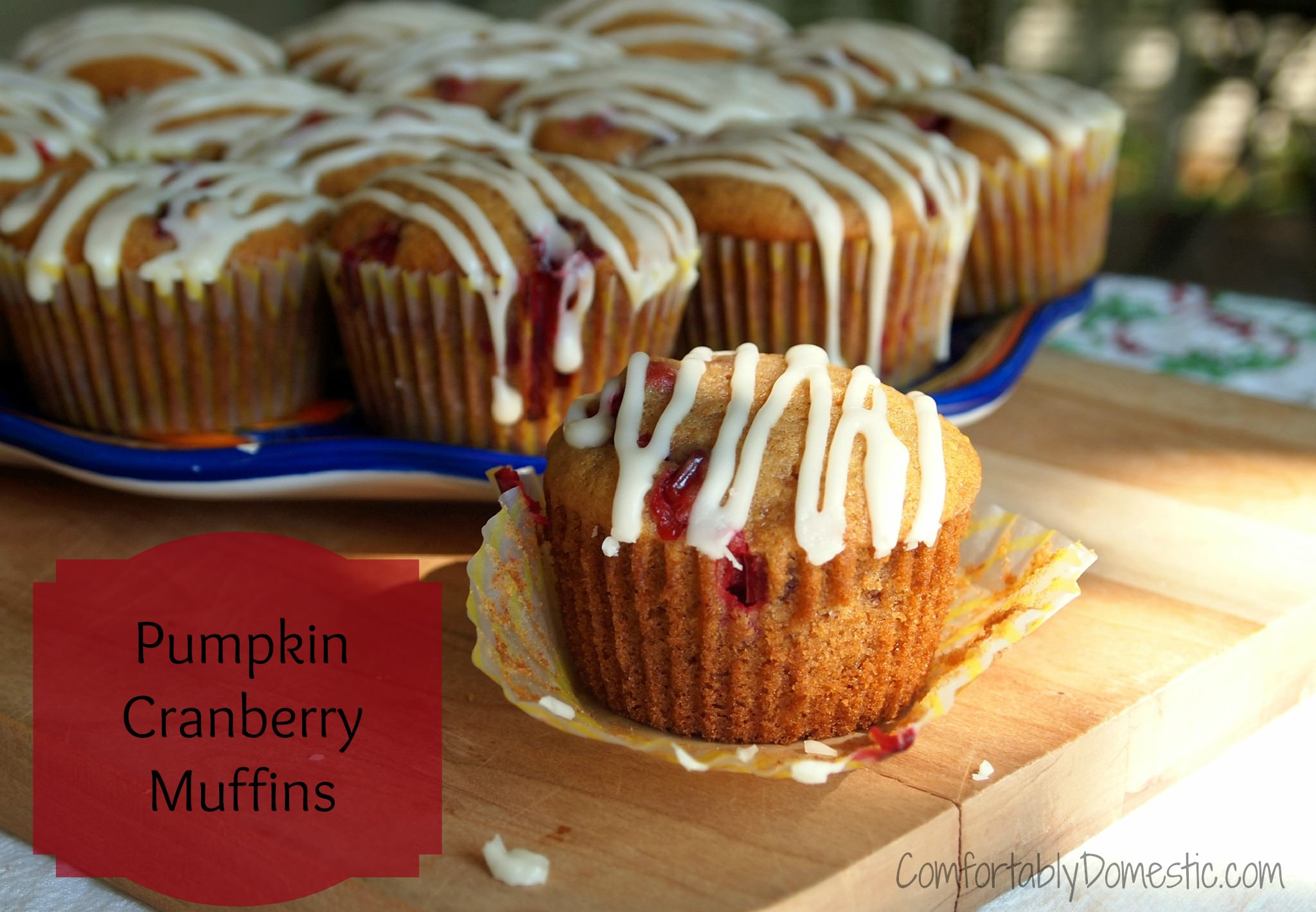 Pumpkin cranberry muffins  use the best flavors of fall to create a moist, fluffy muffin for breakfast or any time snack. The drizzle of sweet glaze on top takes them over the top. | ComfortablyDomestic.com