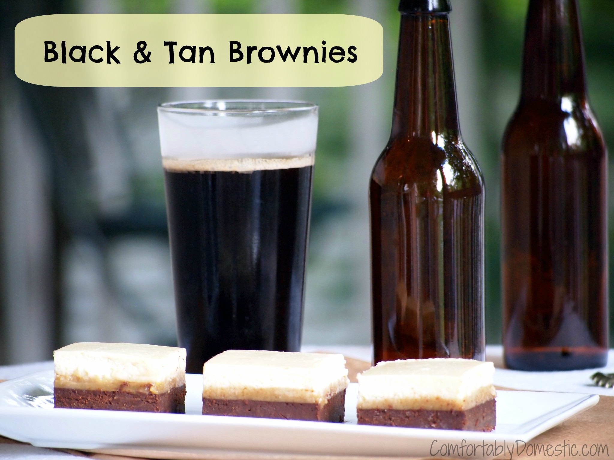 Black and tan brownies are the ultimate brownie treat for beer lovers! A layer of blondies are covered with stout infused brownies and a thick cheesecake layer sits on top. | ComfortablyDomestic.com