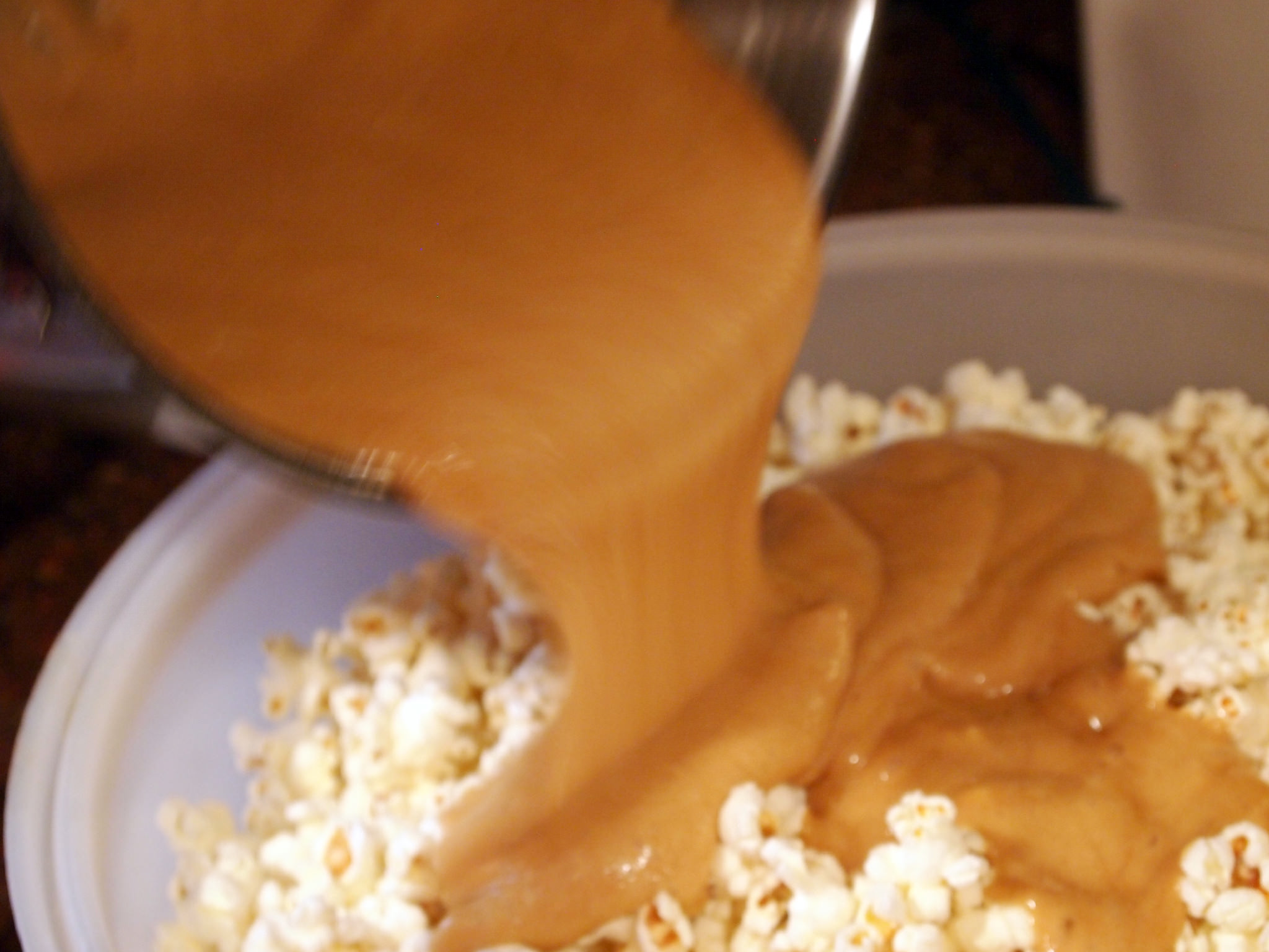 coat popcorn with caramel to make vanilla caramel corn