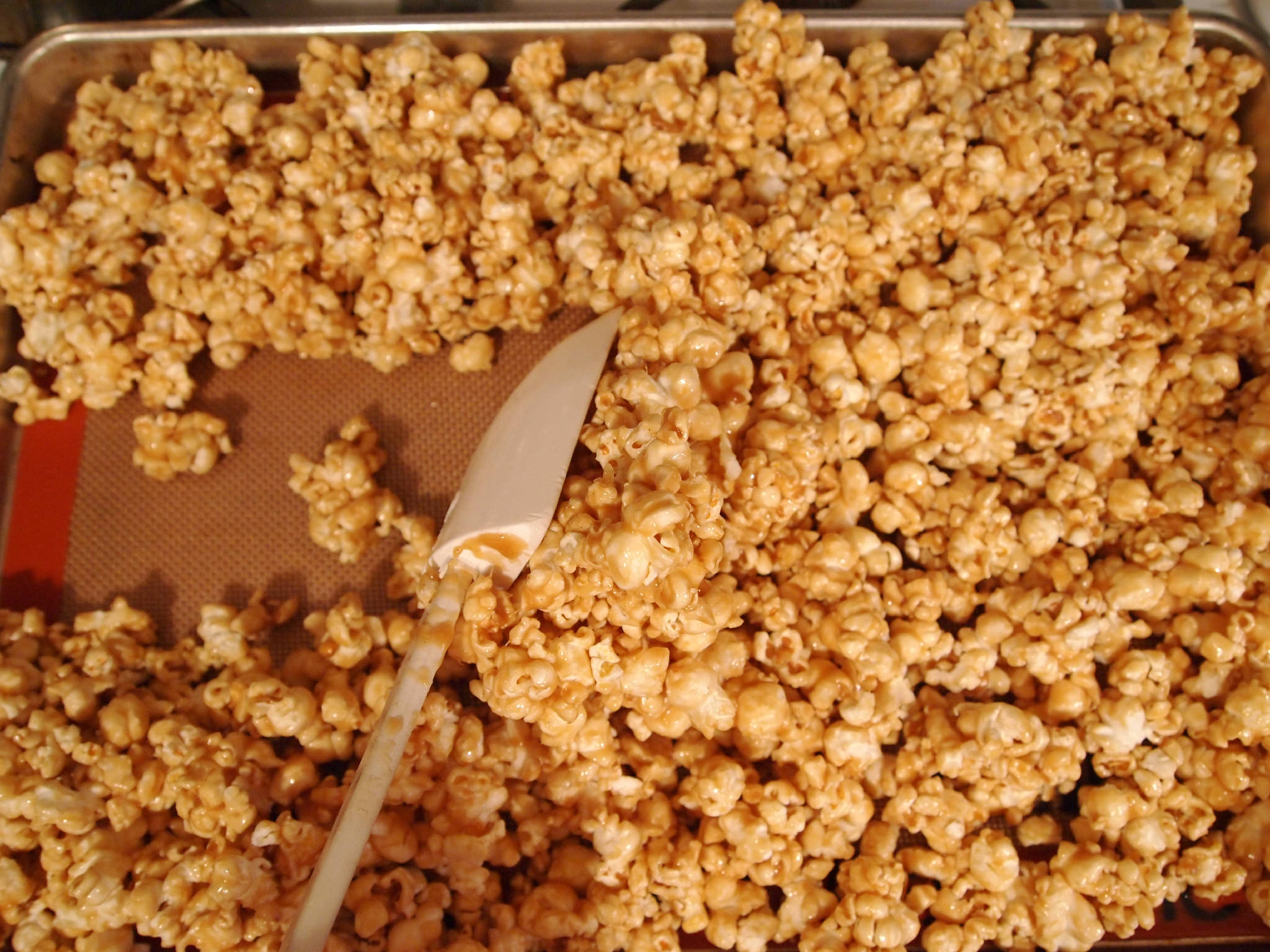 stir and break clumps in vanilla caramel corn