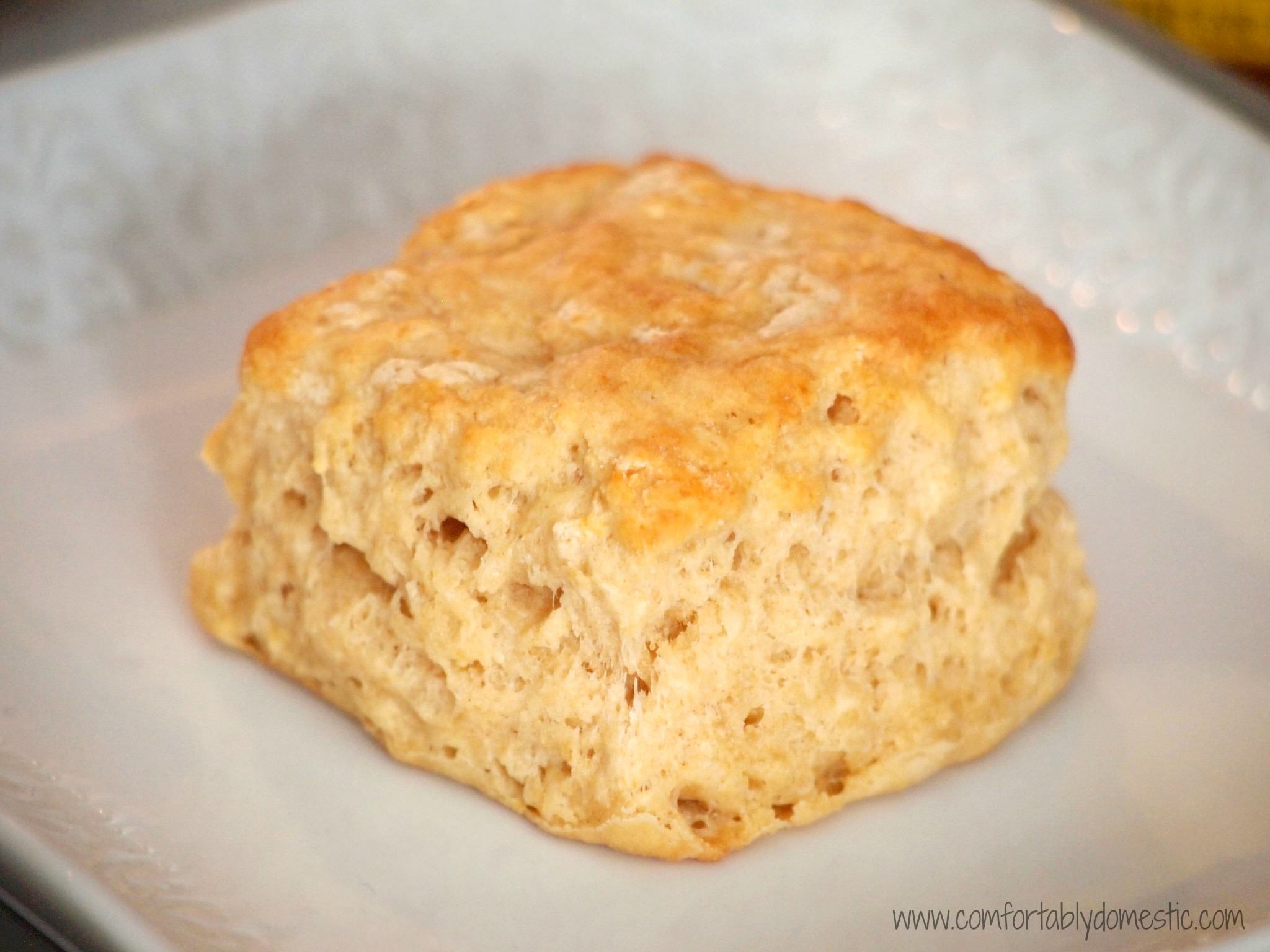 Whole Wheat Buttermilk Biscuits are flaky, buttery biscuits, filled with whole grain goodness. Perfect for breakfast sandwiches or with a meal. | ComfortablyDomestic.com