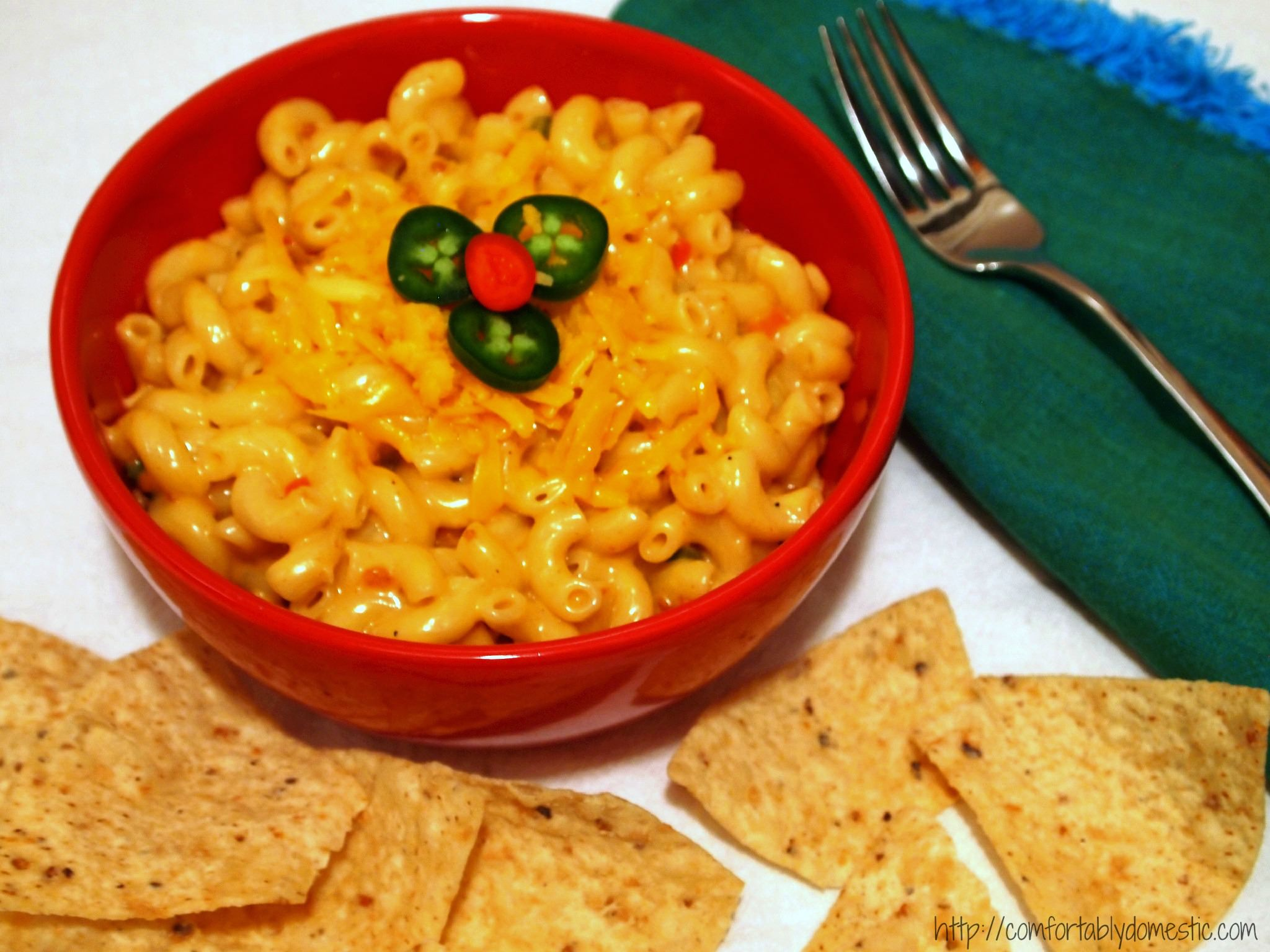 Queso macaroni and cheese is tender macaroni, drenched in a creamy Wisconsin cheese sauce, peppered with all the flavors of a queso dip. | ComfortablyDomestic.com