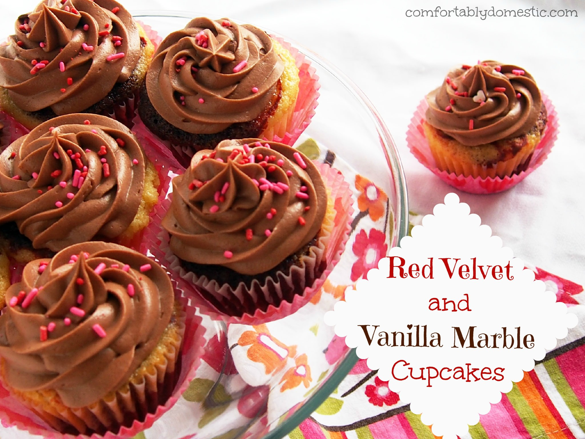 Red Velvet Vanilla Marble Cupcakes are a delicious combination of red velvet cake, marbled with moist vanilla cake. Topped with creamy, rich milk chocolate buttercream frosting. | ComfortablyDomestic.com