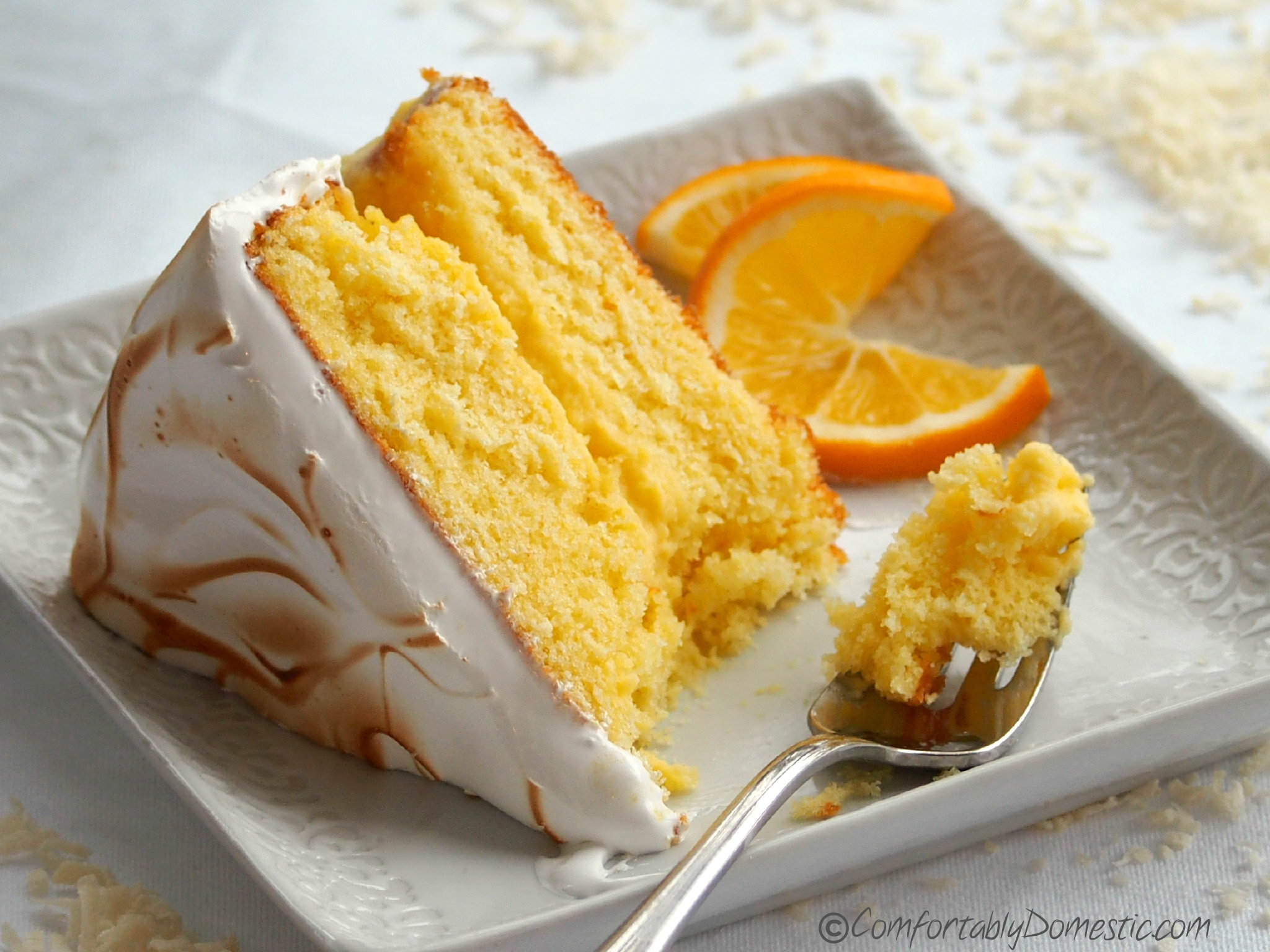 Coconut Meyer Lemon Cake with Swiss Meringue | ComfortablyDomestic.com
