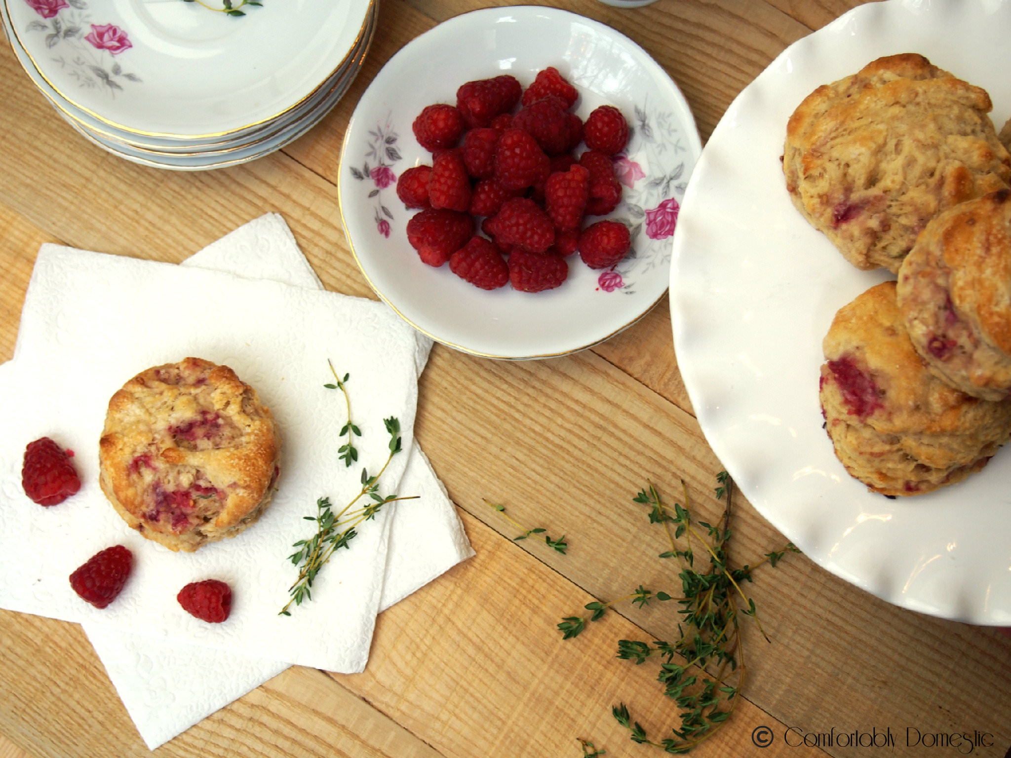 Raspberry thyme goat cheese biscuits are the perfect treat with a hot cup of coffee or afternoon tea. Tender and flaky, with just the right touch of raspberry sweetness to compliment the thyme and creamy goat cheese. | ComfortablyDomestic.com