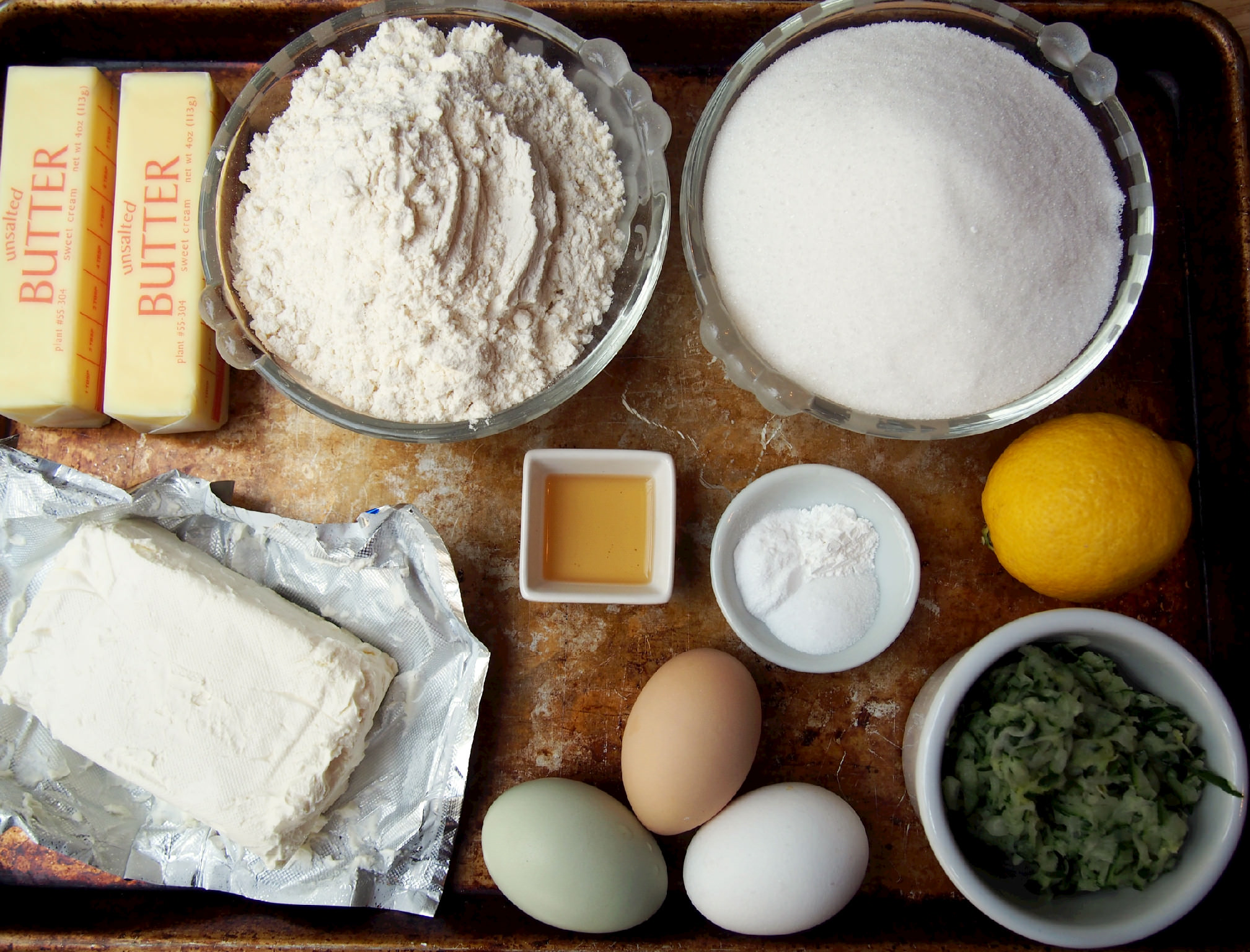 Ingredients to make zucchini bundt cake with lemon cream glaze
