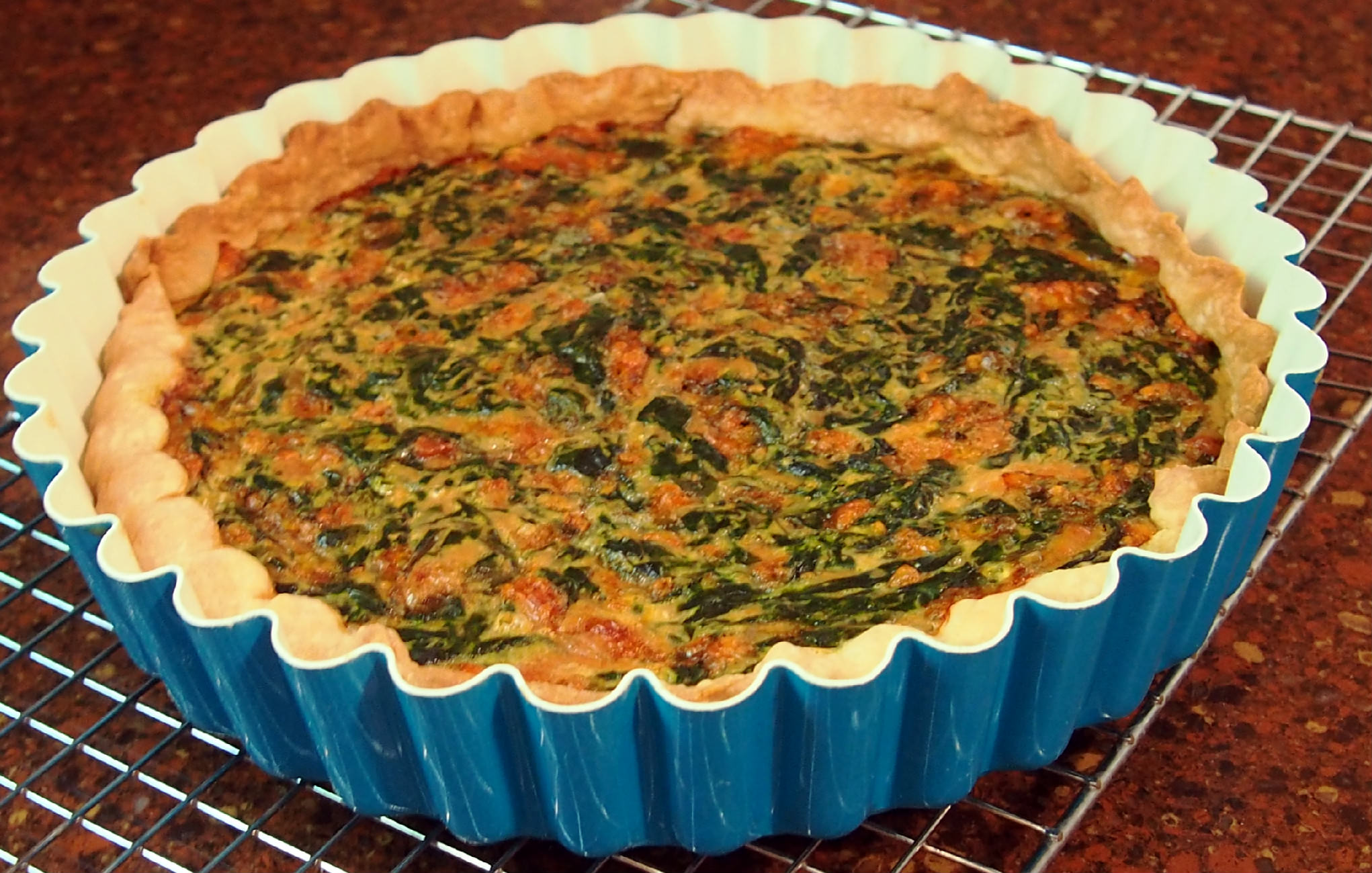 Fresh spinach, acquired through a CSA (Community Supported Agriculture) food co-op goes into making this egg-based, meatless, fresh spinach tart. | ComfortablyDomestic.com