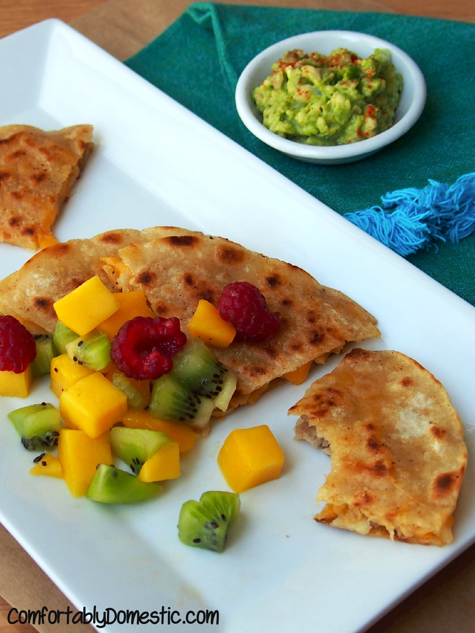 Garlic Pork Quesadillas with Mango Salsa are any easy dinner that you can make using leftovers! | ComfortablyDomestic.com