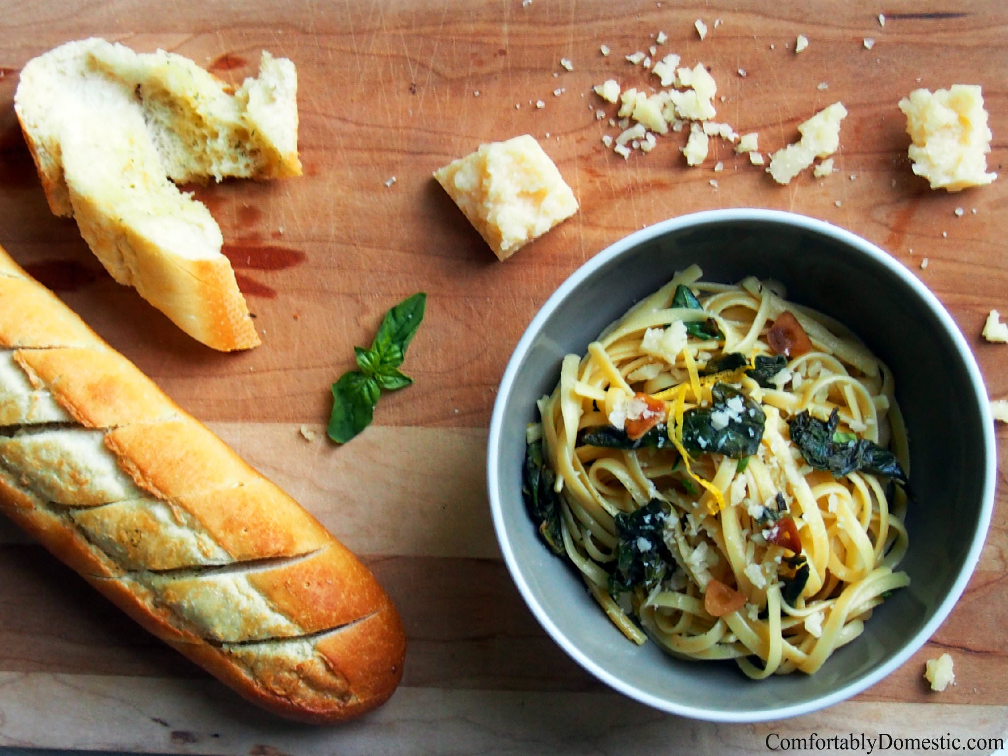 Lemon garlic linguine with kale is a delicious and easy to make weeknight dinner. Adding fresh kale gives this dish a burst of color and health benefits. | ComfortablyDomestic.com