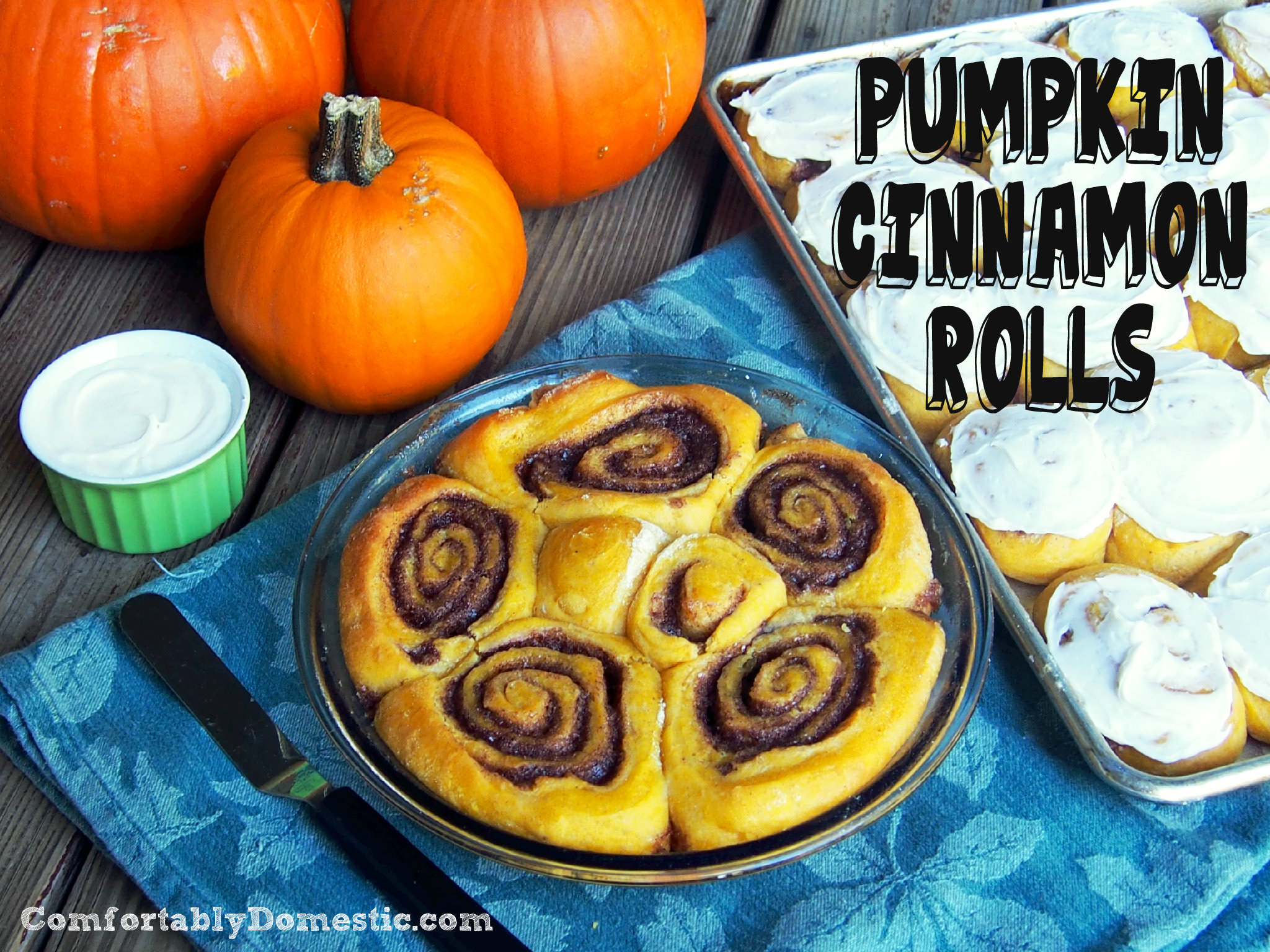 Pumpkin cinnamon rolls usher in the cool comfort of autumn any time of the year. Piping hot, and just dripping with cream cheese icing. | ComfortablyDomestic.com