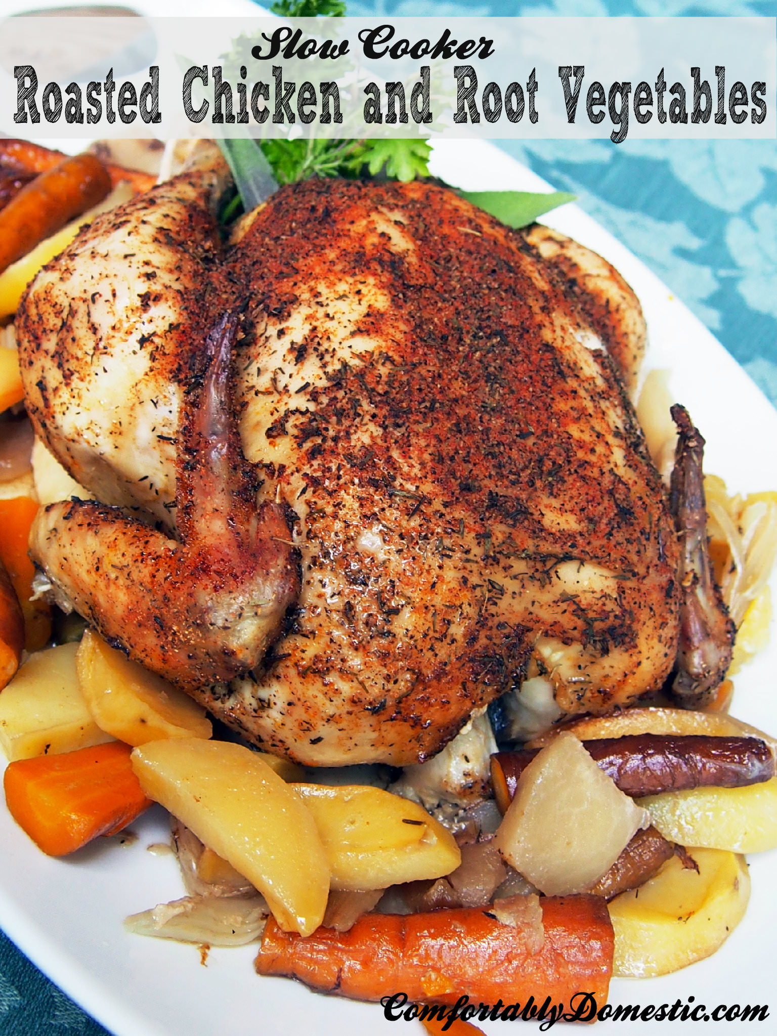 Slow cooker whole roasted chicken is the perfect dinner! Succulent, seasoned chicken on a bed of root vegetables, slow roasted all day for a flavorful and fragrant weeknight meal. | ComfortablyDomestic.com