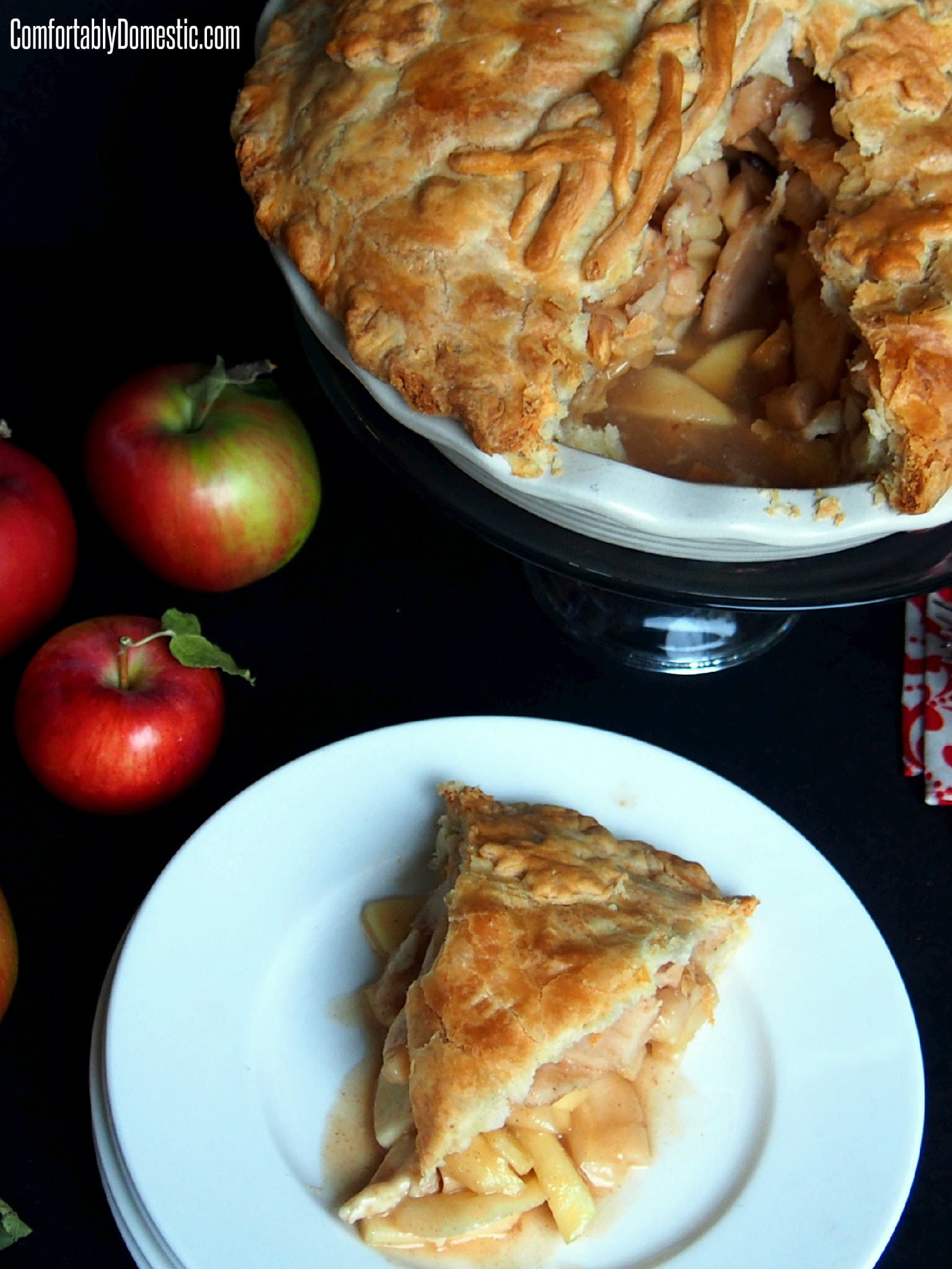 Mile high apple pie is a deep dish take on an American Classic Apple Pie--stuffed with a variety of tart apples, bound together in a caramel-like filling.| ComfortablyDomestic.com