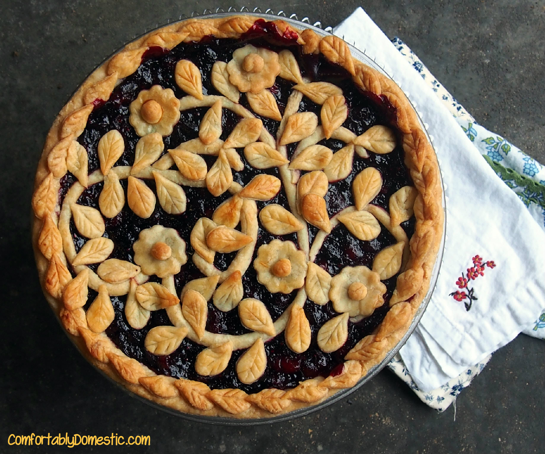 Very berry cherry pie, with its fresh cranberries, wild blueberries, and tart cherries, has show stopping flavor. This pie is bound to be requested again and again. || ComfortablyDomestic.com