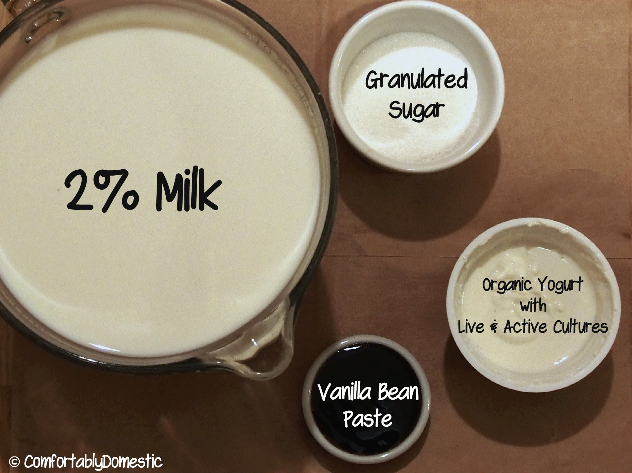 4 simple ingredients needed to make homemade vanilla Greek yogurt.