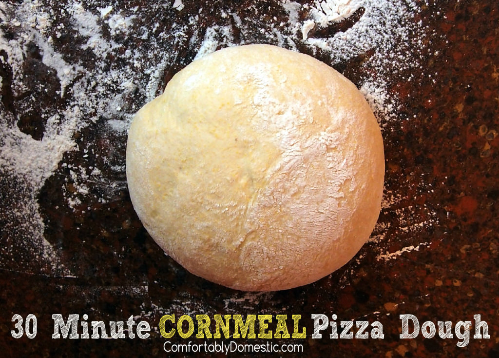 30 Minute Cornmeal Pizza Dough - Cornmeal pizza dough makes homemade pizza crust that's ready for toppings in 30 minutes, helping you create perfect pizzeria-style pizzas at home! || ComfortablyDomestic.com