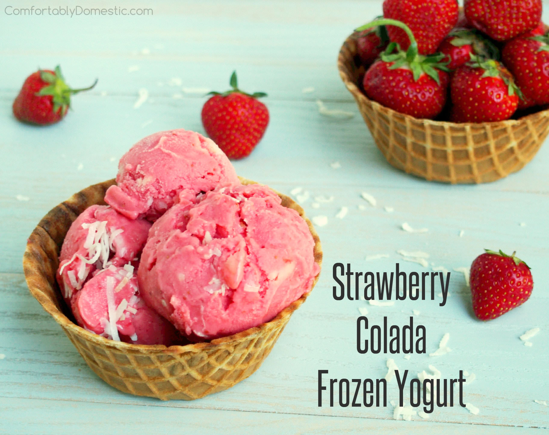 Strawberry colada frozen yogurt is a refreshing treat on a warm summer day. Ripe, juicy strawberries mingle with tangy pineapple and sweet coconut for a dreamy, creamy homemade frozen dessert. | ComfortablyDomestic.com