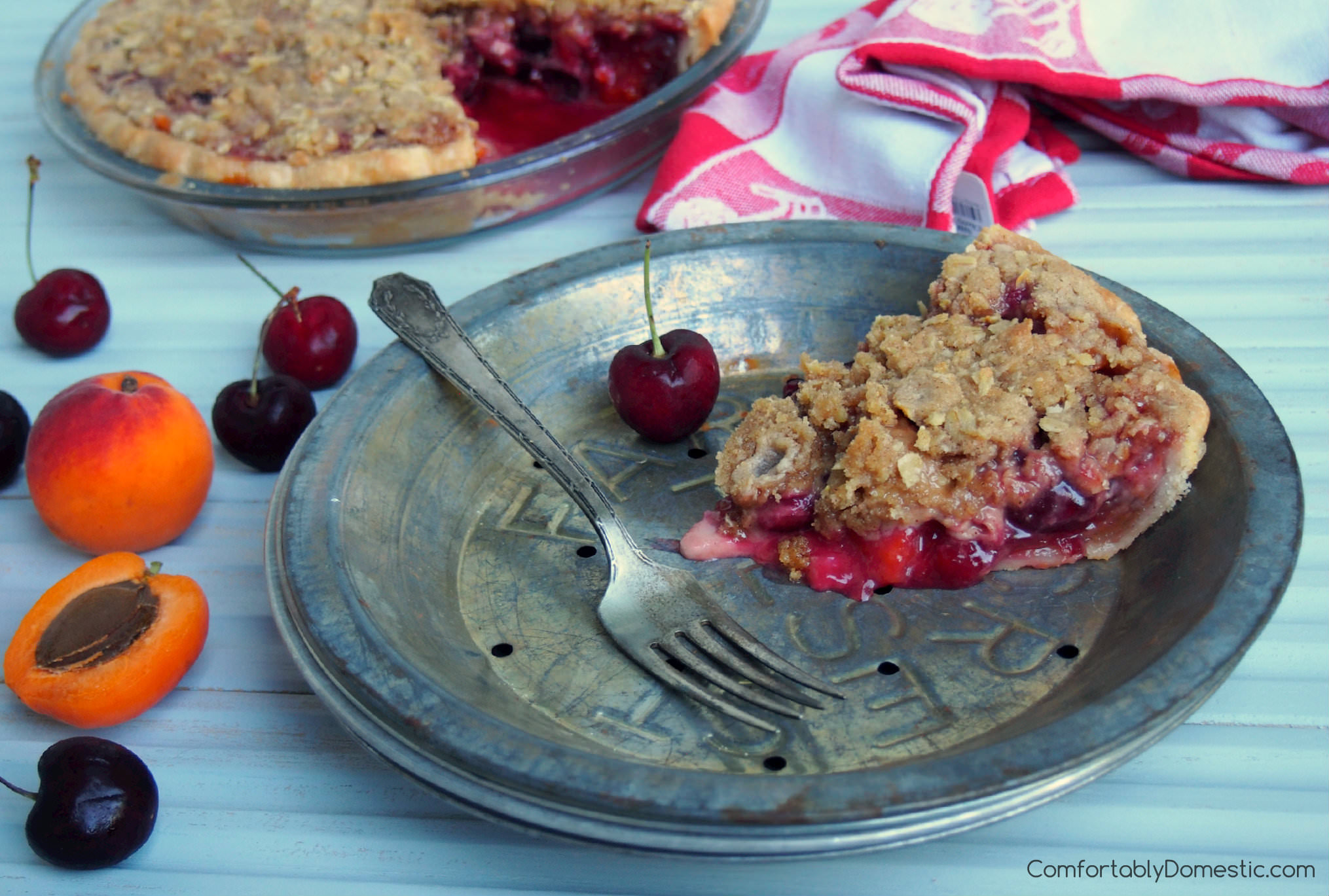Sweet Cherry Apricot Crumb Pie blends juicy sweet cherries with with tangy apricots for a fresh burst of summer in every bite! | ComfortablyDomestic.com