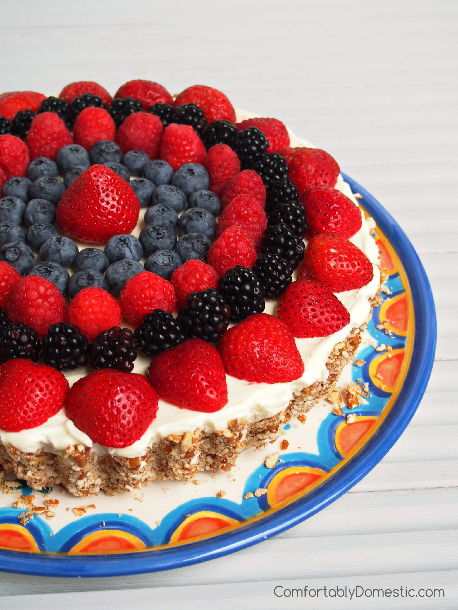 Lemon Mousse Tart with Pretzel Crust and Berries | ComfortablyDomestic.com