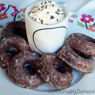 Baked Chocolate Sour Cream Doughnuts | ComfortablyDomestic.com are soft, rich chocolate doughnuts enrobed in a sweet, vanilla bean glaze.