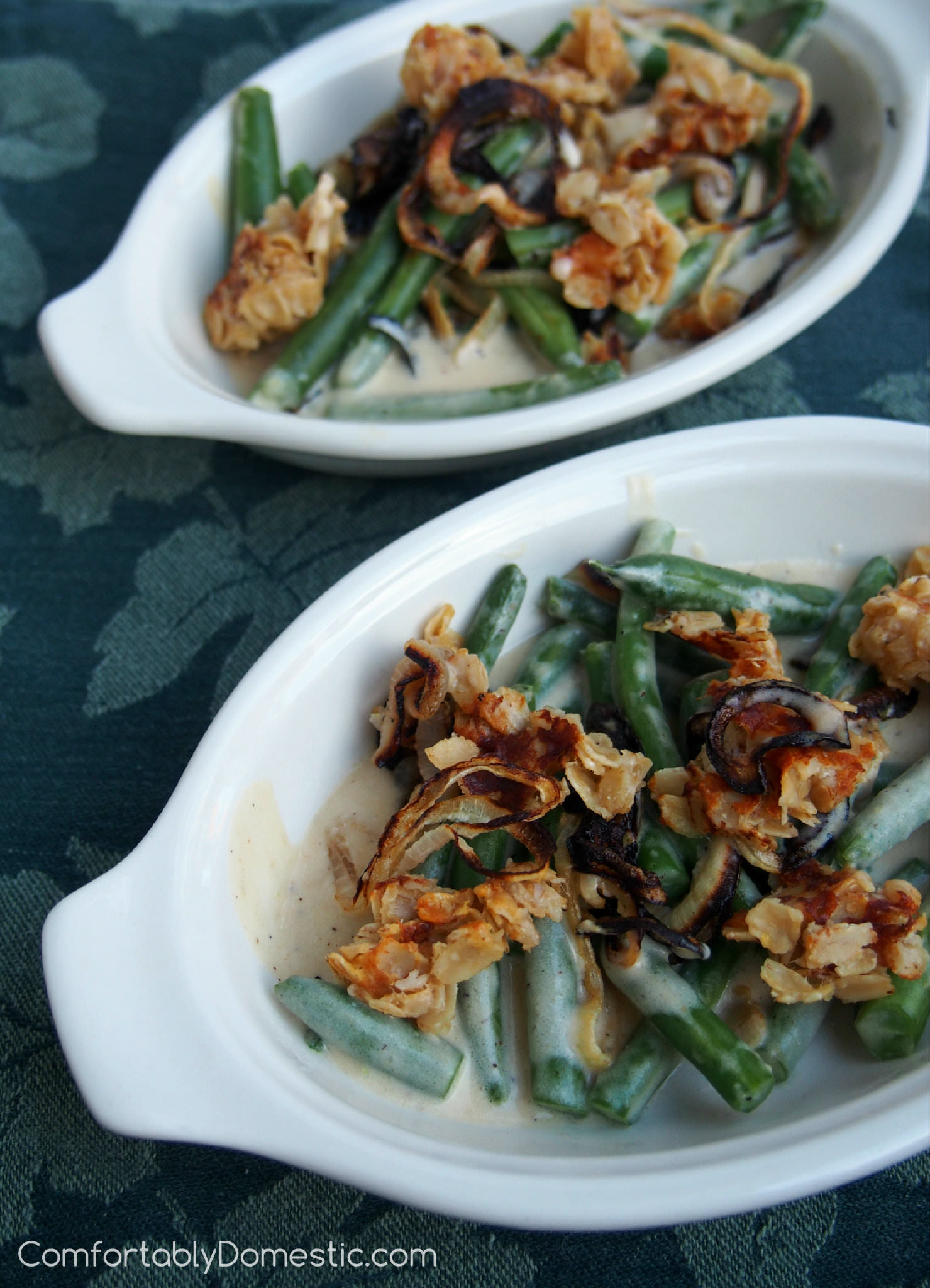 Modern Green Bean Casserole | ComfortablyDomestic.com uses fresh green beans slathered in a sauce made from scratch, and topped with real, crisp onions, and a savory cheese streusel.