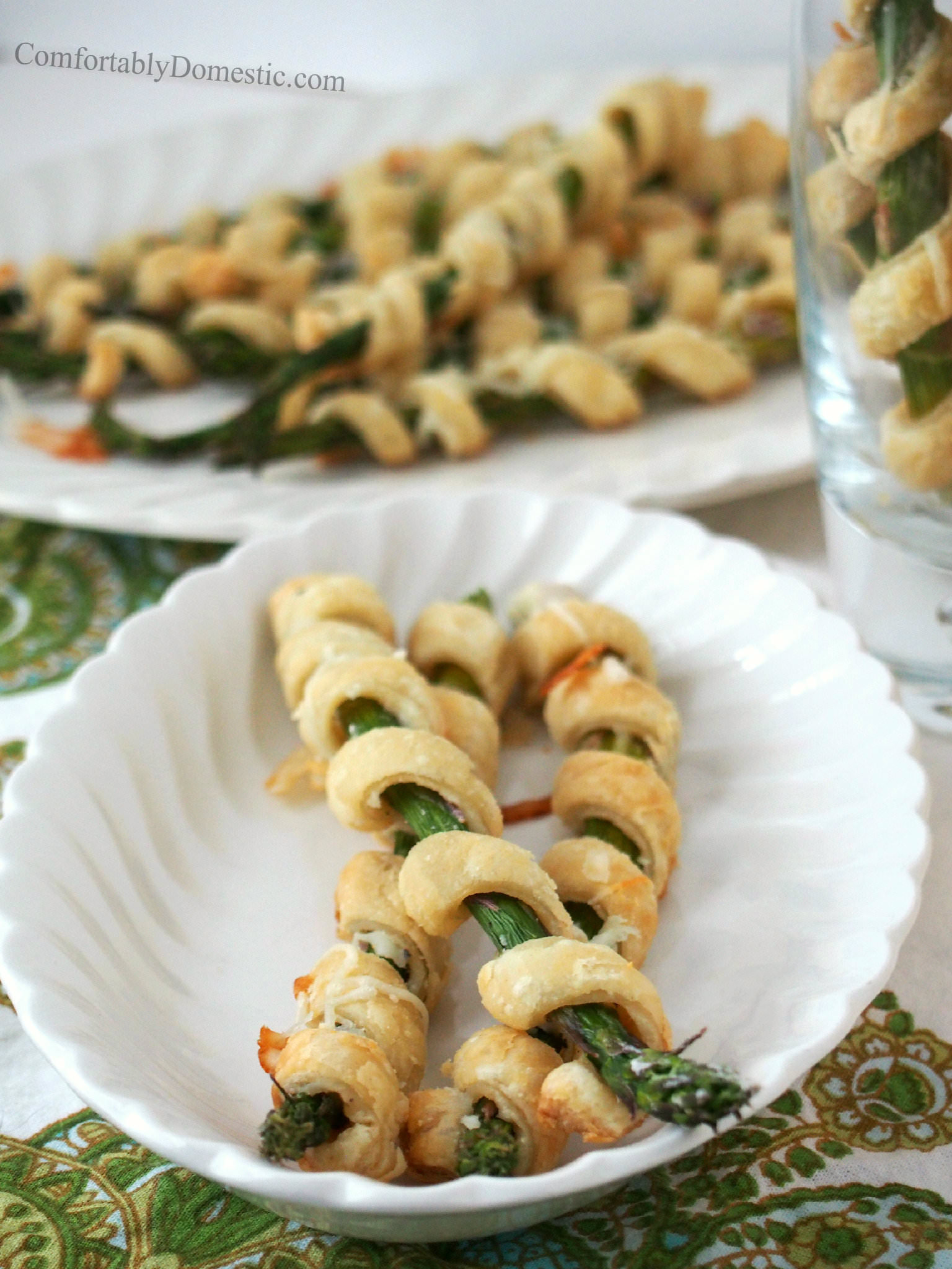 A great use for fresh asparagus is to make cheesy asparagus pastry spirals! Tangy Asiago cheese and buttery pastry entwine fresh asparagus in this simple appetizer recipe. | ComfortablyDomestic.com