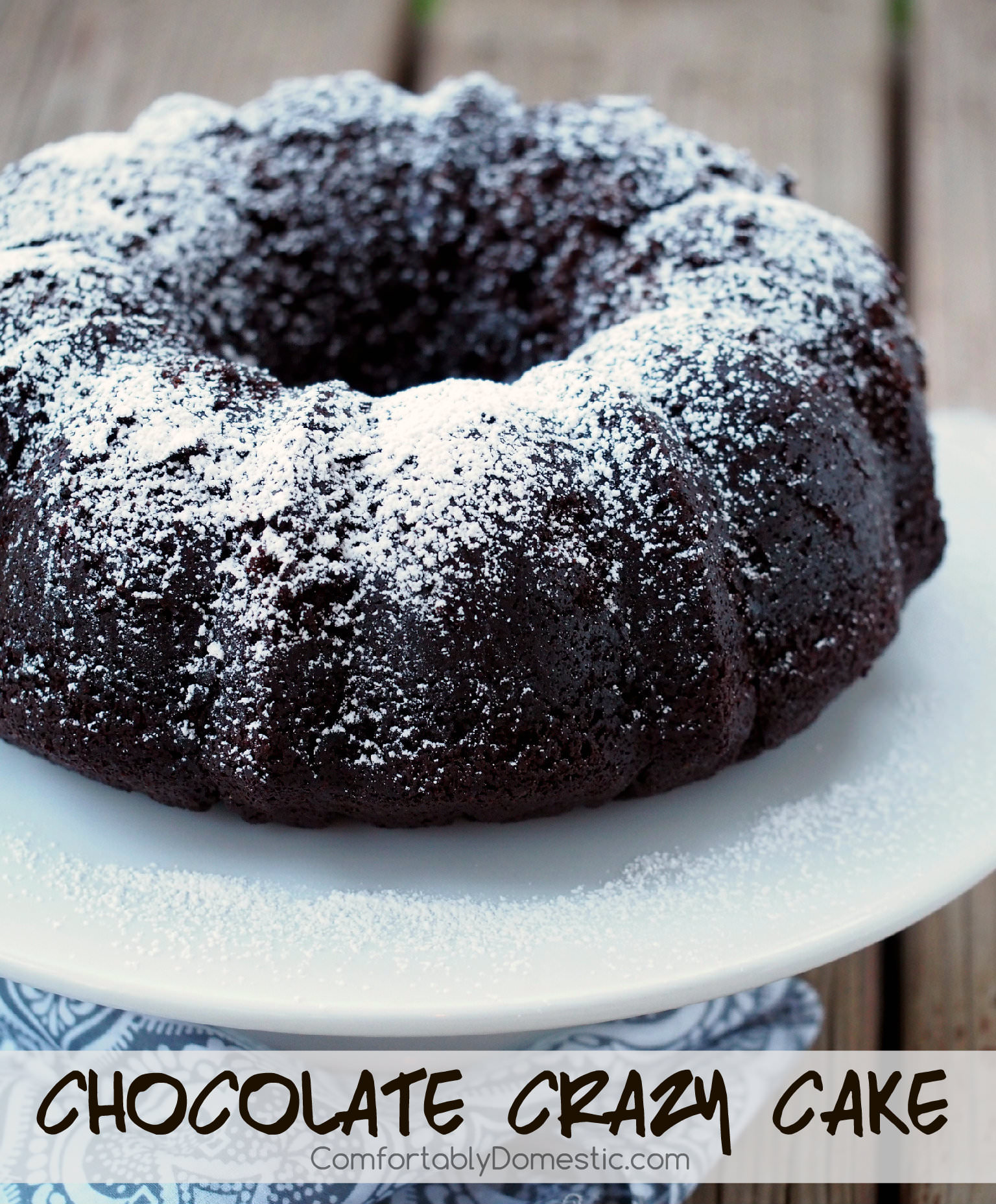 Chocolate Crazy Cake - A sinfully decadent chocolate cake made from scratch that comes together in a jiffy. The recipe is a little crazy because it's made without eggs, and yet the resulting cake is still rich with a tender crumb. | ComfortablyDomestic.com