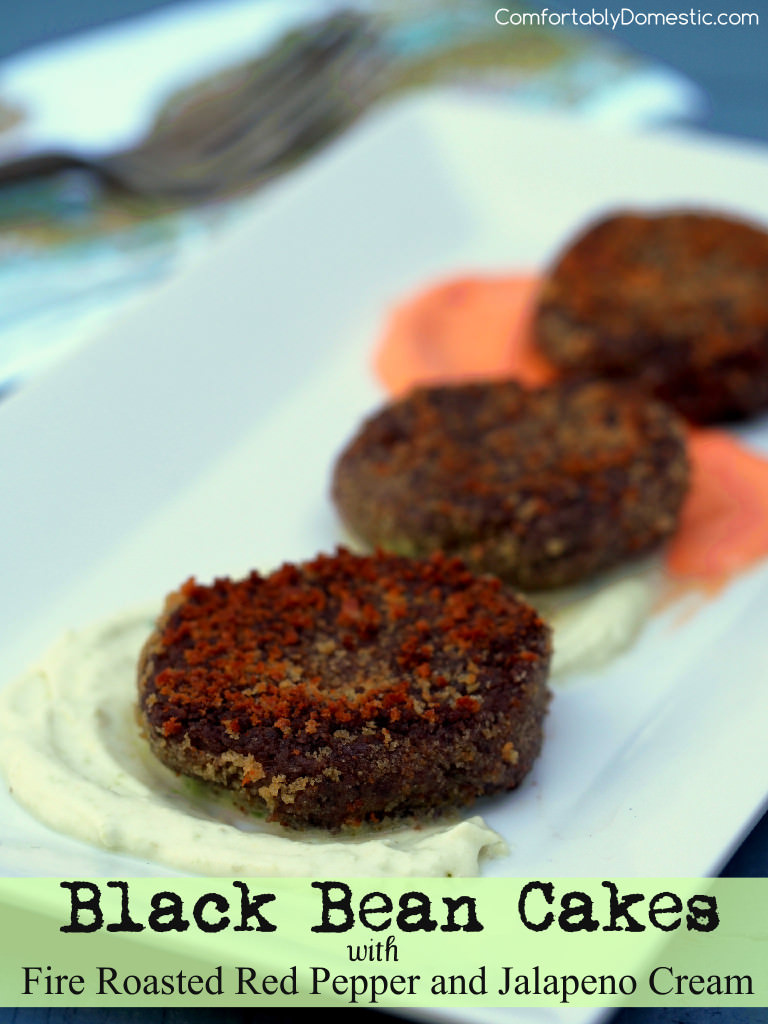 Black bean cakes, crispy exterior, with a silky smooth interior, artfully mingle with fire roasted red pepper and jalapeno cream. | ComfortablyDomestic.com