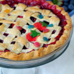 Mixed-Berry-Pie - Fresh, sweet strawberries, juicy blueberries, and tart raspberries happily mingle in this mixed berry pie that is as delightfully inviting as summer itself.| ComfortablyDomestic.com