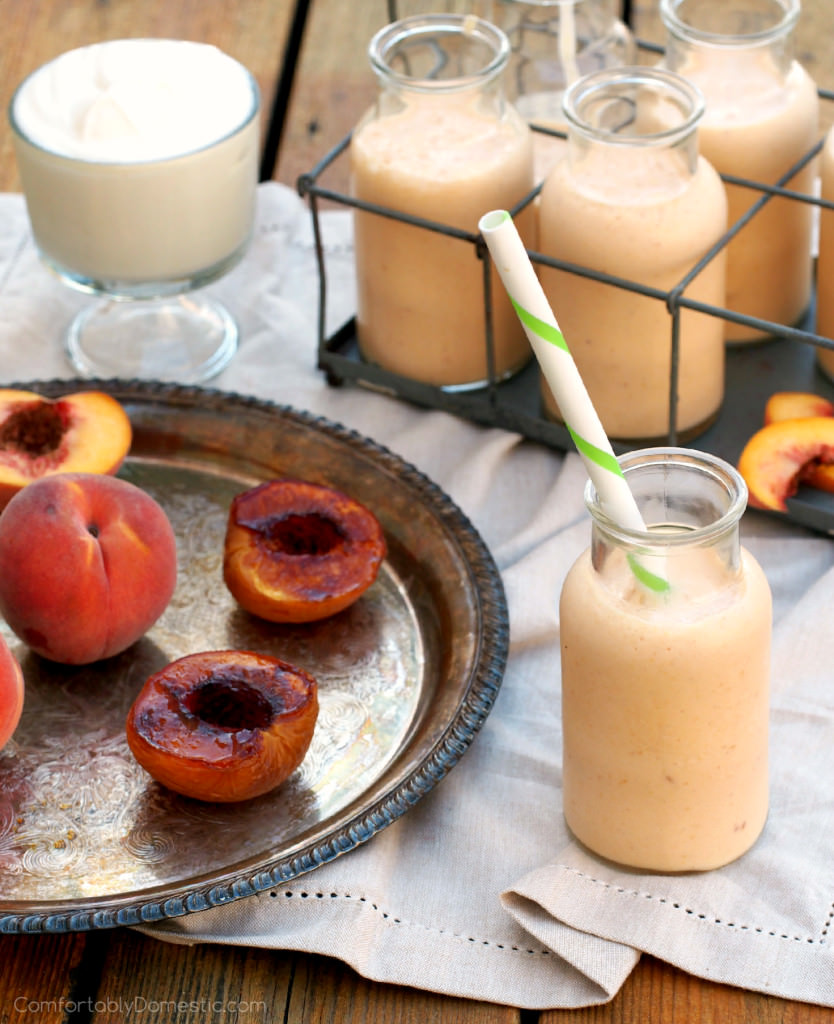 Honey Roasted Peach Smoothies have a touch of butter and honey to bring out the nutty sweetness. Blended with yogurt and milk for a simply delicious smoothie. | ComfortablyDomestic.com