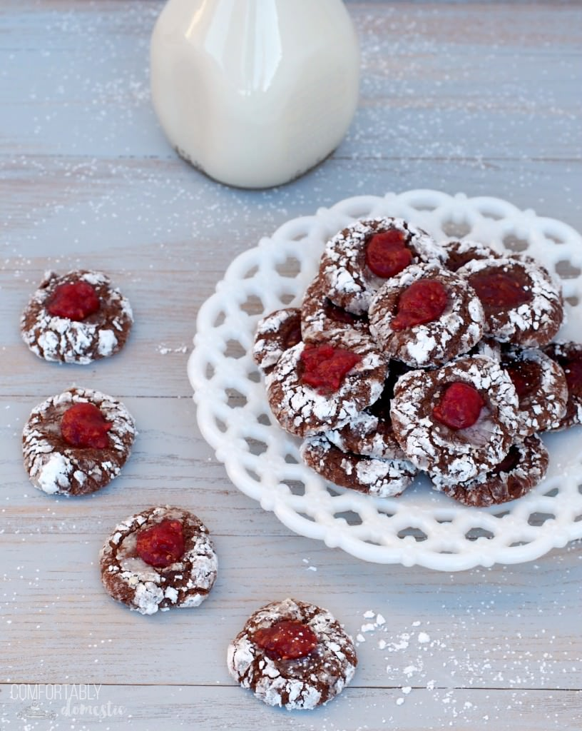 Chocolate thumbprint cookies are the perfect Christmas cookie! Tangy raspberry jam, cradled in lush chocolate cookie dough, coated with a heavy dusting of powdered sugar. They're a sweet cookie that virtually melts on the tongue. | ComfortablyDomestic.com