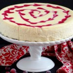 Cranberry-Swirl-Cheesecake - Thick, rich, and super creamy cheesecake adorned with a tangy swirl of fresh cranberries makes dessert a perfectly decadent experience. | ComfortablyDomestic.com