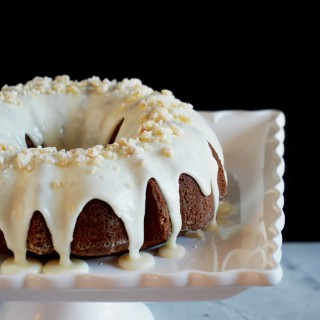 Gingerbread-Cake-with-Orange-Cream-Glaze - Richly spiced Gingerbread Cake tickles the tongue with added depth of molasses, brightened with citrus notes of orange. | ComfortablyDomestic.com