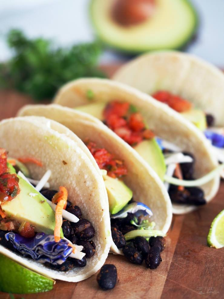 Spicy-Roasted-Black-Bean-Tacos is an easy vegetarian meal made with seasoned black beans, oven roasted to enhance the depth of the spices and compliment the satisfying fresh flavors. These tacos are anything but bland or ordinary!