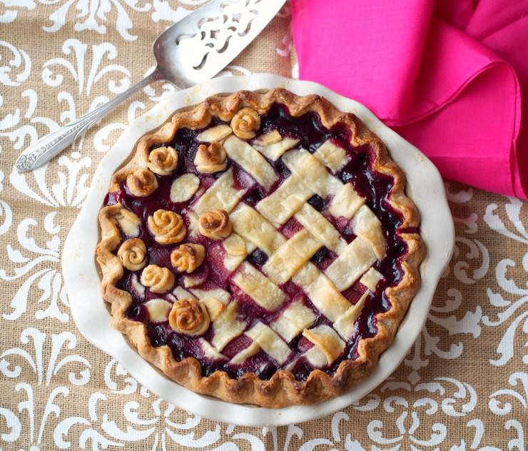 Double-Cherry-Berry-Pie mingles both sweet and tart cherries with wild blueberries and strawberries to give this pie a show stopping flavor that is destined to become a family favorite.