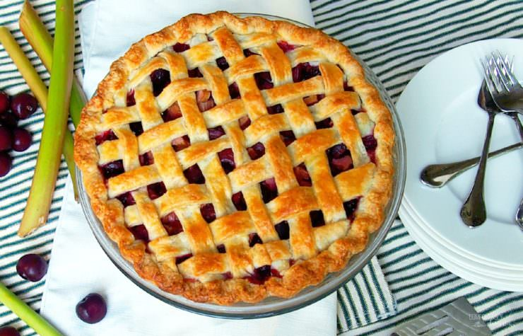 Sweet-Cherry-Rhubarb-Pie marries plump sweet cherries with tart rhubarb for a juicy pie that's bursting with summer sunshine in every bite.