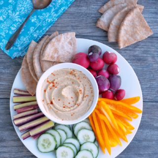 Skinny-Hummus-made-with-yogurt is nice and creamy with a healthy bite of garlic—low fat Greek yogurt cuts down on the extra calories found in traditional recipes.