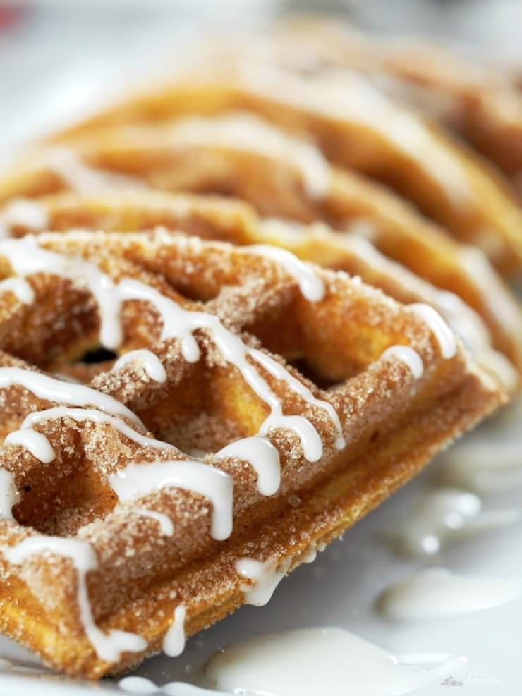 Pumpkin-Churro-Waffles-with-Cream-Cheese-Icing, reminiscent of the popular street fair snack, are loaded with all the pumpkin and warm spiced flavors of fall with crisp, cinnamon sugared edges and an interior texture that practically melts in your mouth.