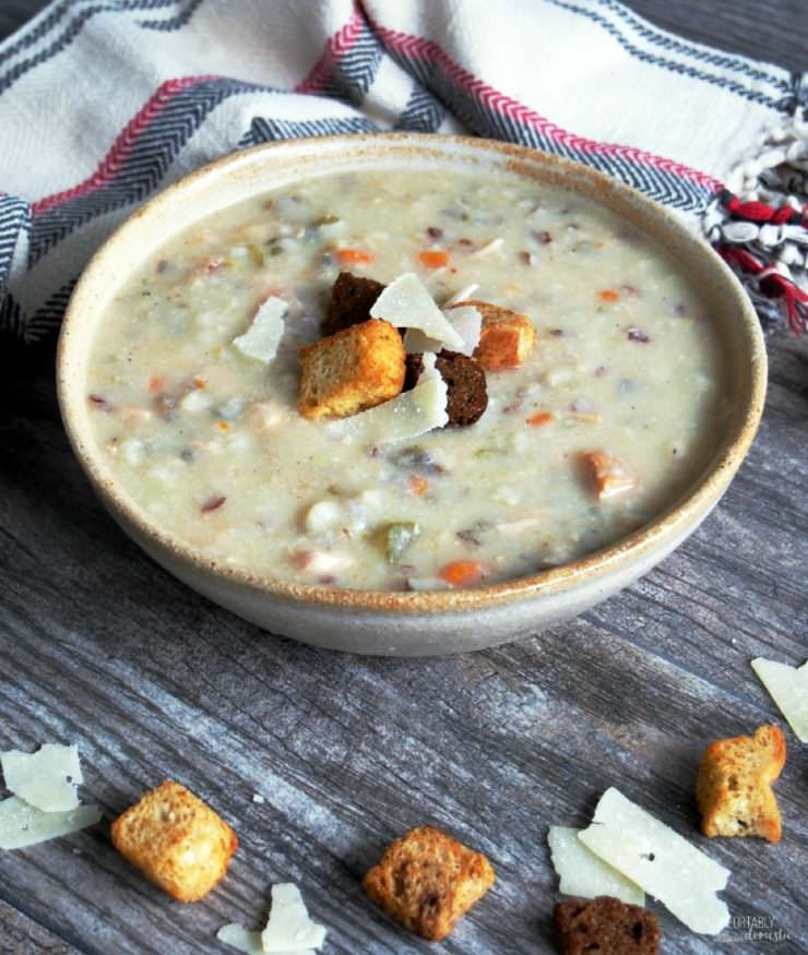 Slow-Cooker-Chicken-Wild-Rice-Soup is a big ol' bowl of savory comfort on a brisk fall day. Studded with vegetables and chewy wild rice, this creamy soup will warm you from the inside out!